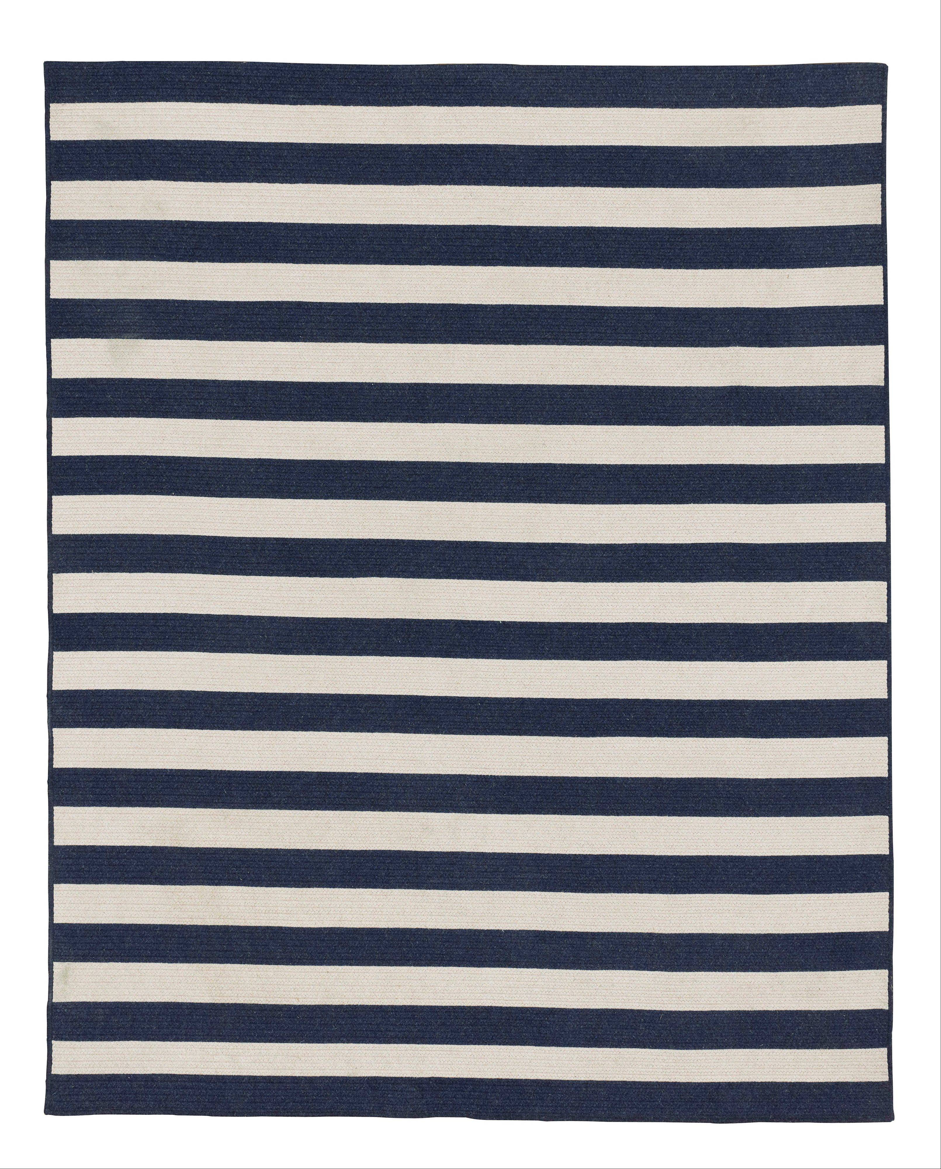 A bold striped, braided wool rug is a great way to introduce navy to a room (www.rhbabyandchild.com). With bold pops of color, or a few soothing neutrals, navy is a fresh trend worth exploring this spring.