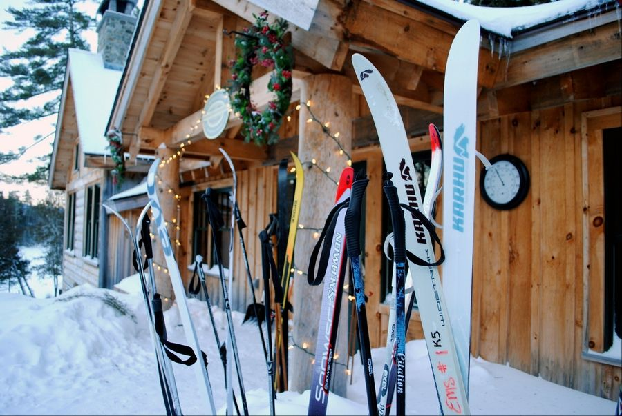 This December 2012 photo shows cross-country skis left by guests outside the Appalachian Mountain Clubís Gorman Chairback Lodge, a backcountry wilderness lodge near Greenville, Maine. In winter, visitors can reach the lodges and cabins only by cross-country skiing in.