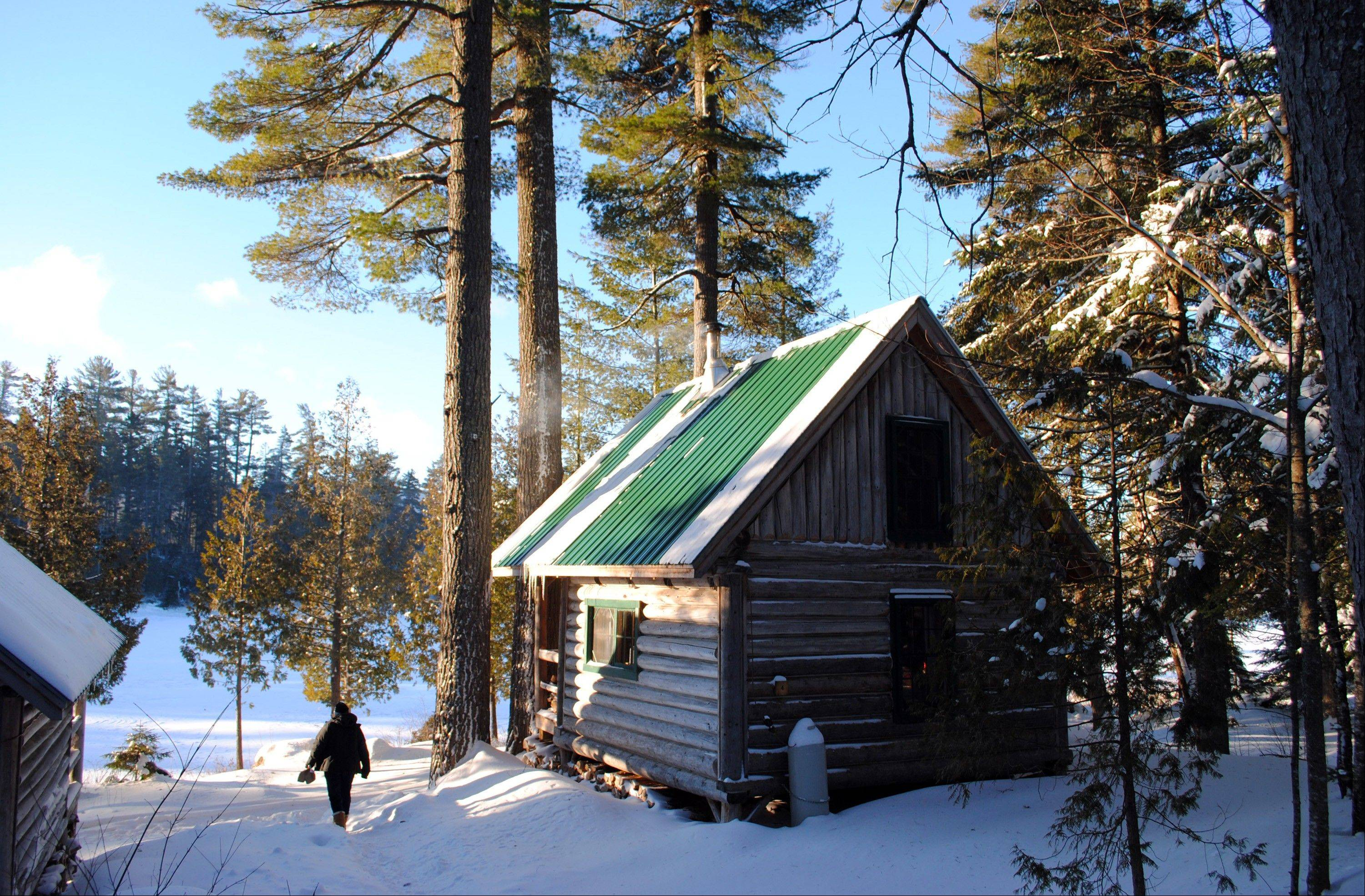 A rustic cabin in the snow at the Appalachian Mountain Club's Gorman Chairback Lodge near Greenville, Maine.