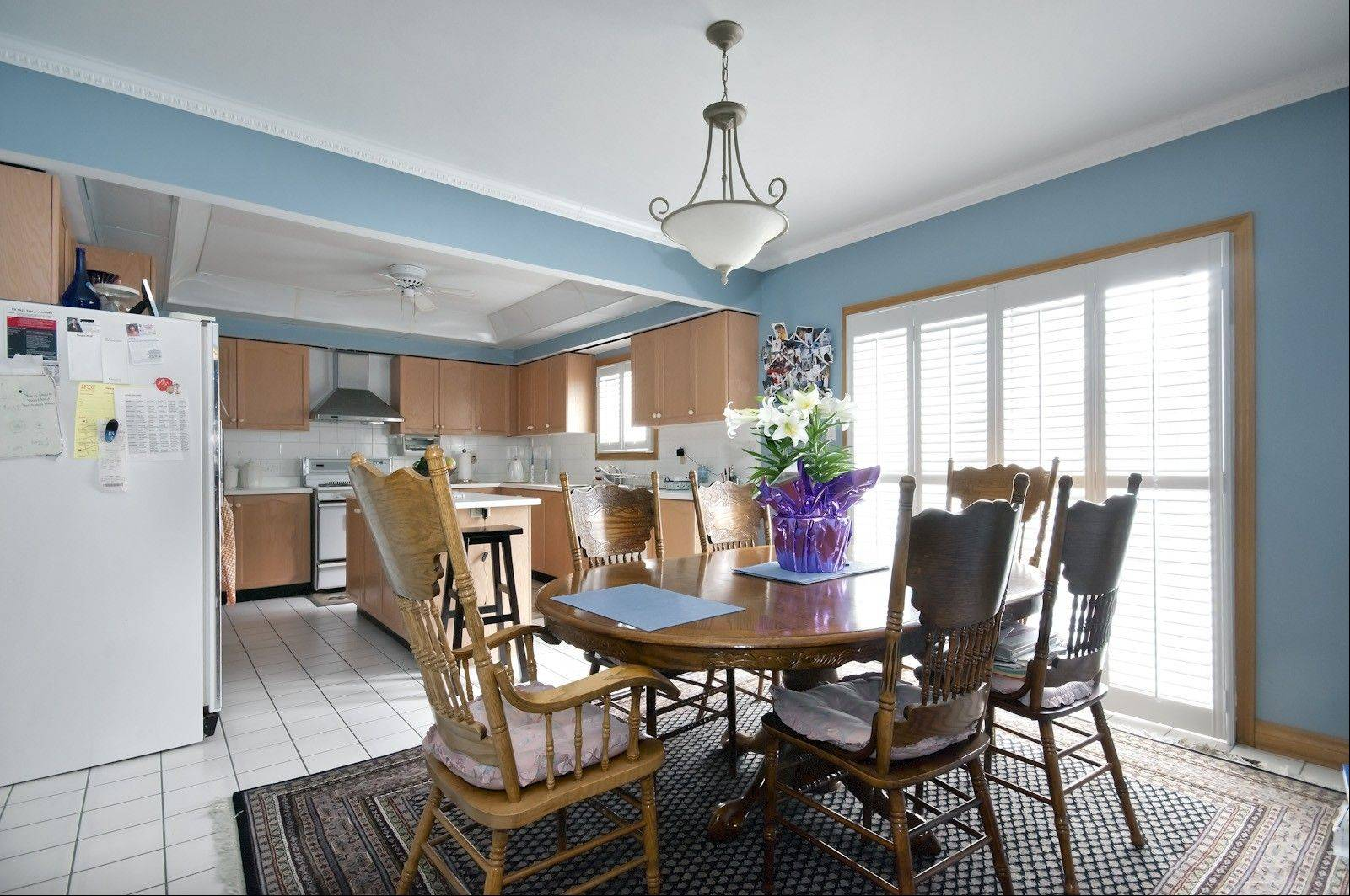 The family's kitchen had good bones, including a functional U-shaped configuration and an island work top seen here before the remodeling project. Therefore, the redesign was more about rejuvenating than renovating.
