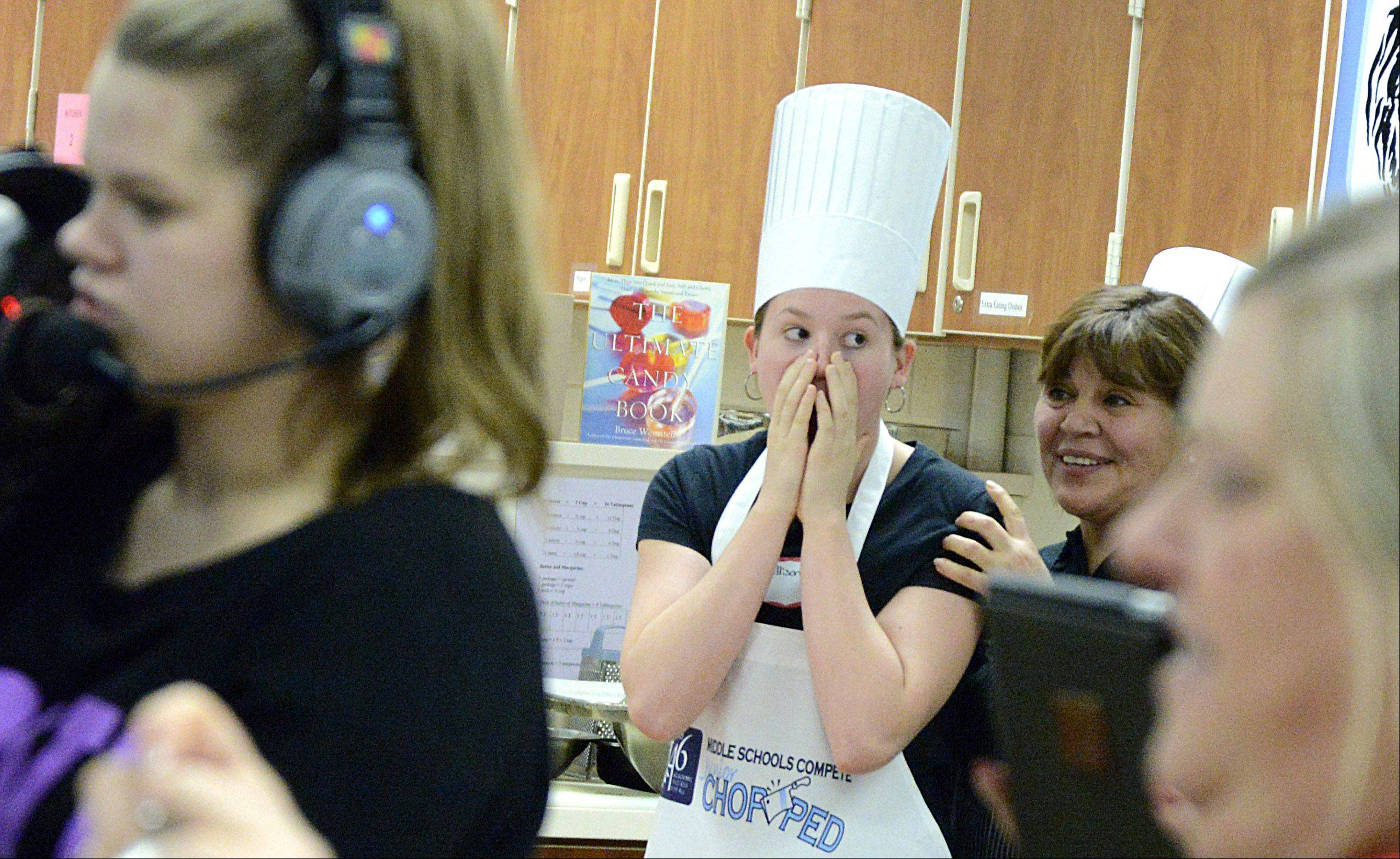 Allison Marsh, 13, of Kimball Middle School and Swaggy Choppers coach Maria Martinez, realize their lunch dish has taken the win in the final round of the Elgin Area School District U-46 Junior Chopped competition Saturday at South Elgin High School.
