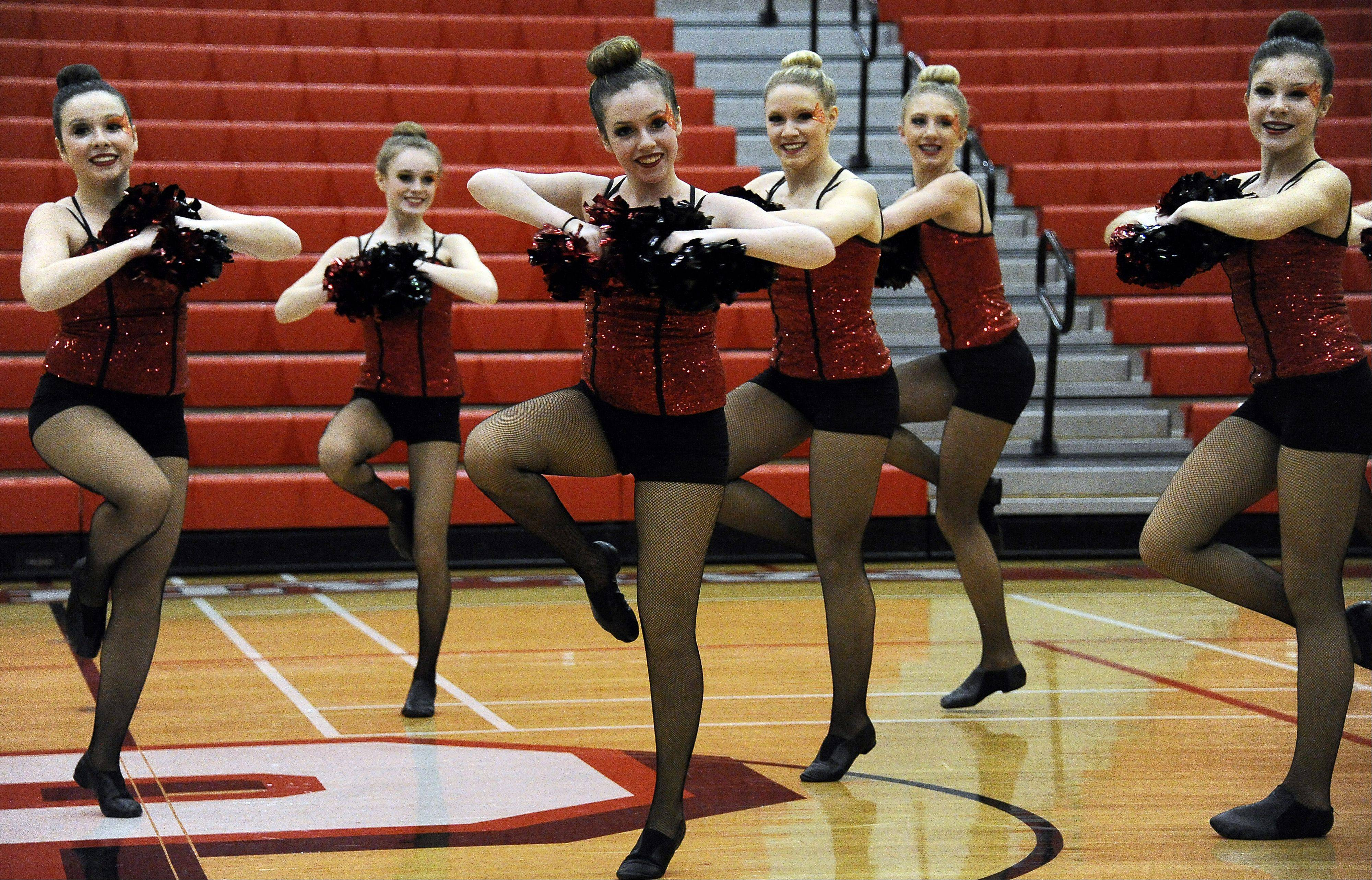 Dancing in the (2A) division are members of South Elgin High School dance squad with Taylor Russo (center) leading the way in the 1st annual Sectional Competition at Palatine High School on Saturday.