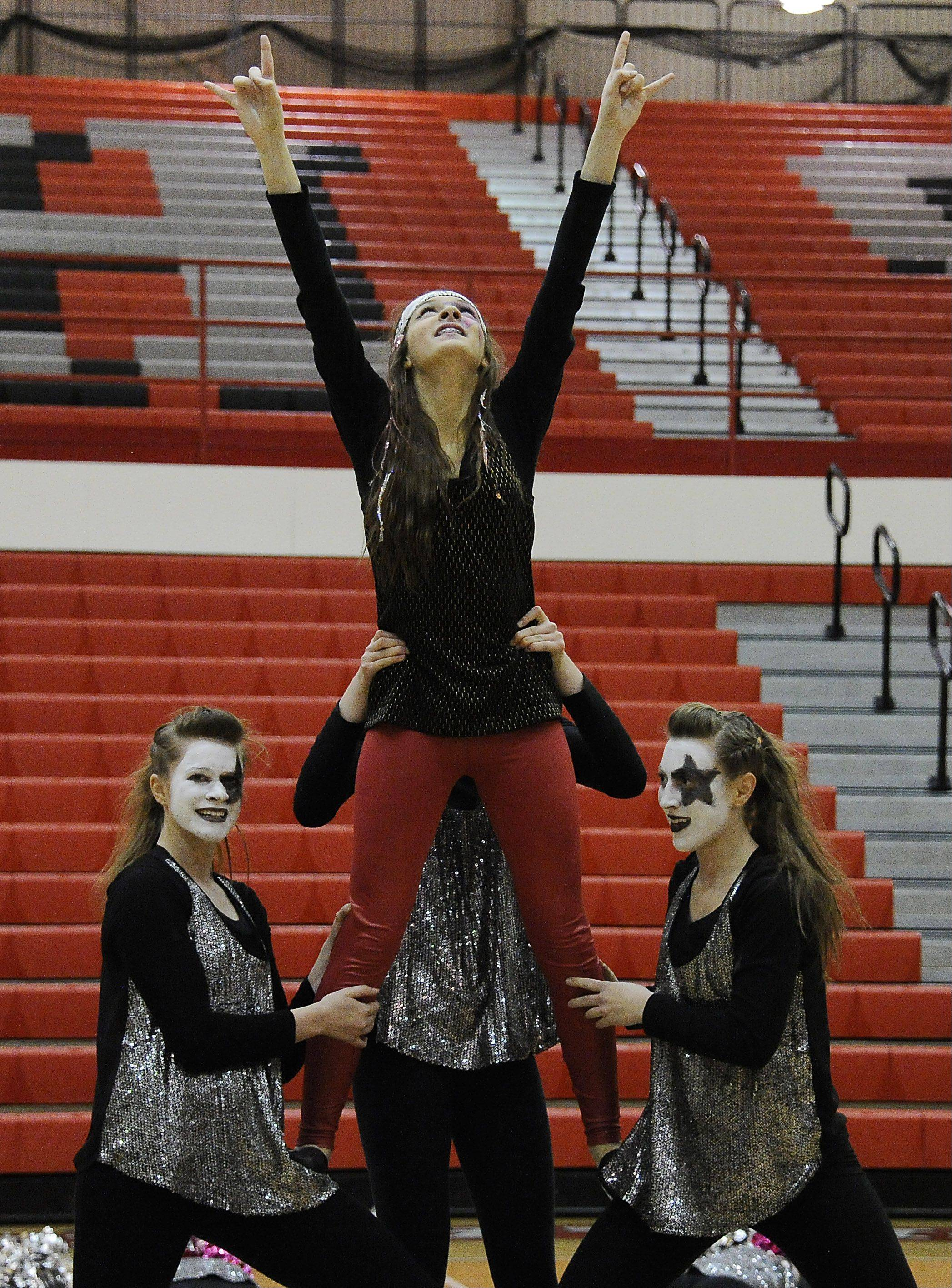 Dancing in the (2A) division are members of Wheaton North High School dance squad with Micheli Venckus (center) leading the way in the 1st annual Sectional Competition at Palatine High School on Saturday.