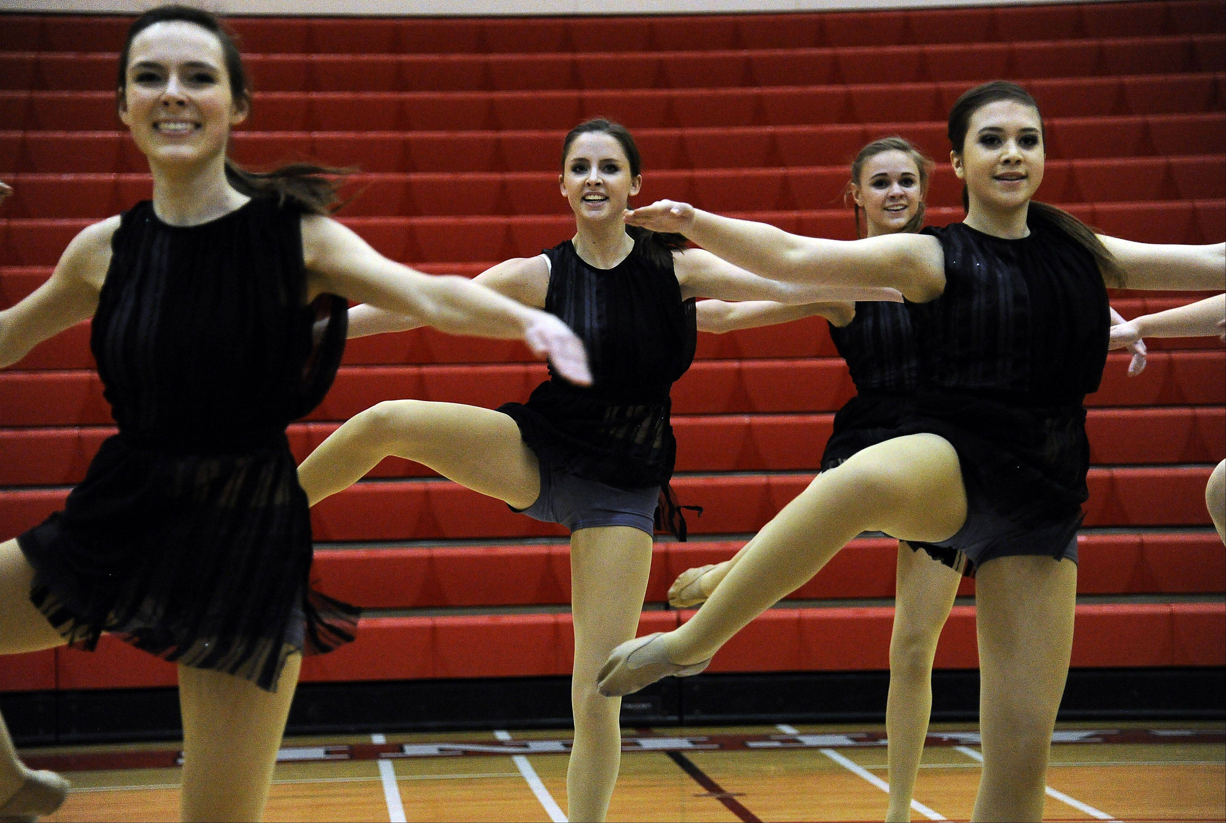 Dancing in the (2A) division are members of St. Charles East High School dance squad with Victoria Finlay (center) leading the way in the 1st annual Sectional Competition at Palatine High School on Saturday.