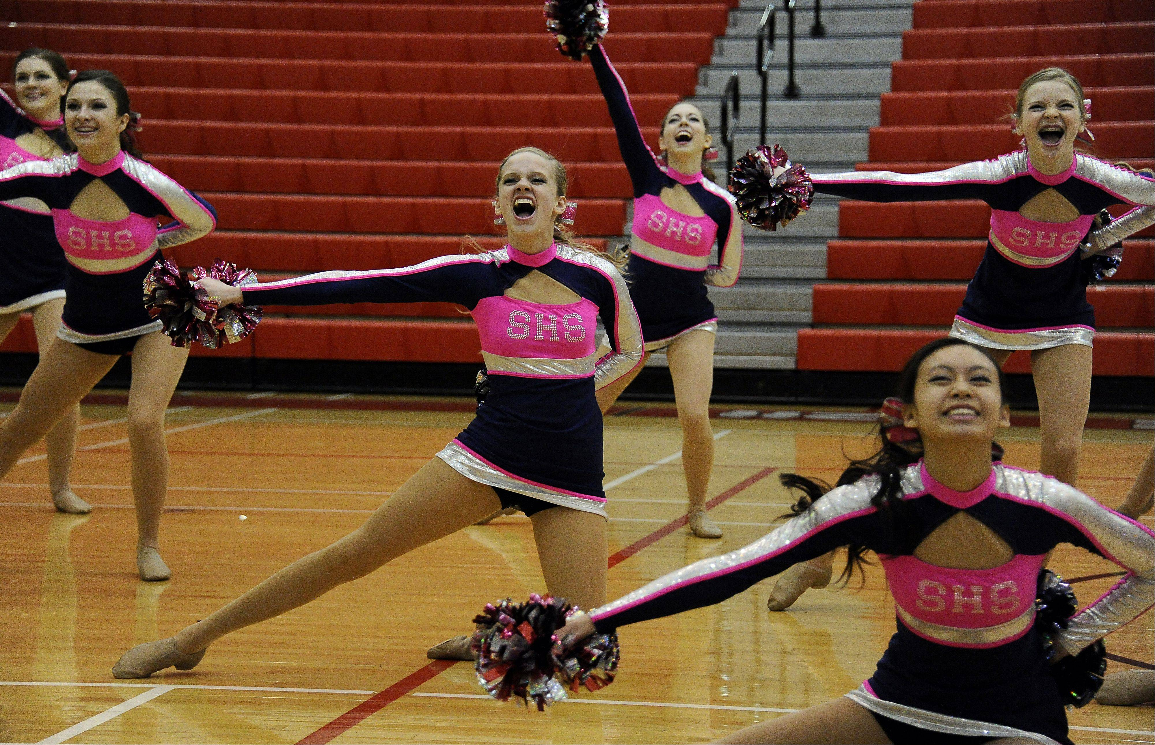 Dancing in the (2A) division are members of Schaumburg High School dance squad with Lauren Birkholz (center) leading the way in the 1st annual Sectional Competition at Palatine High School on Saturday.
