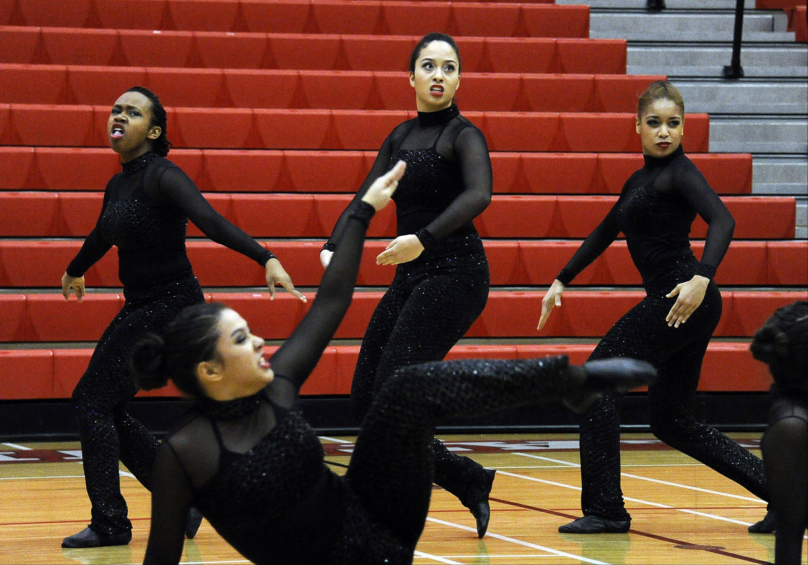 Dancing in the (2A) division are members of the Maine East High School dance squad with Sade Howell (center) leading the way in the 1st annual Sectional Competition at Palatine High School on Saturday.