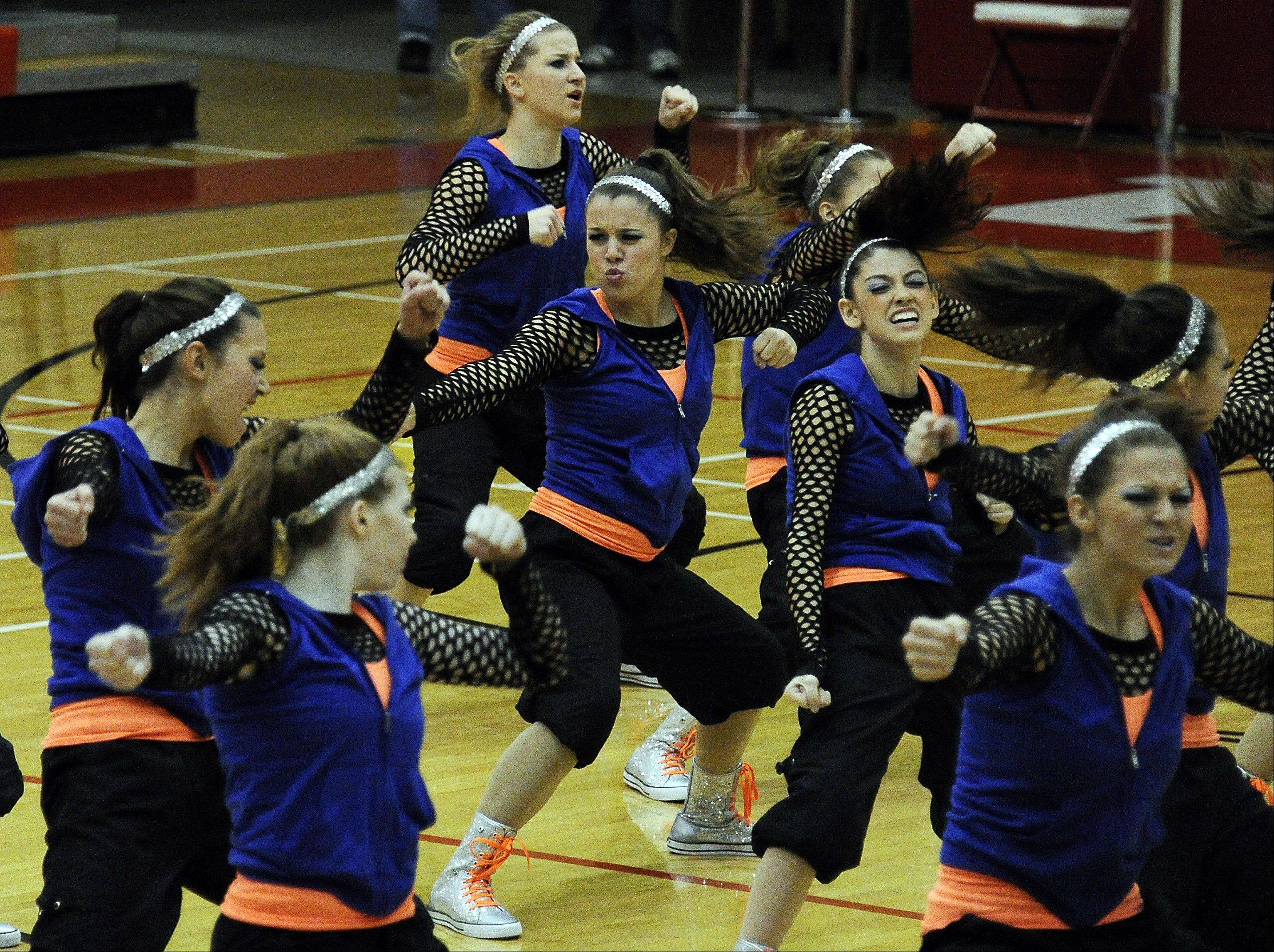 Dancing in the (2A) division are members of Fenton High School dance squad with Stephanie Bennett (center) leading the way in the 1st annual Sectional Competition at Palatine High School on Saturday.