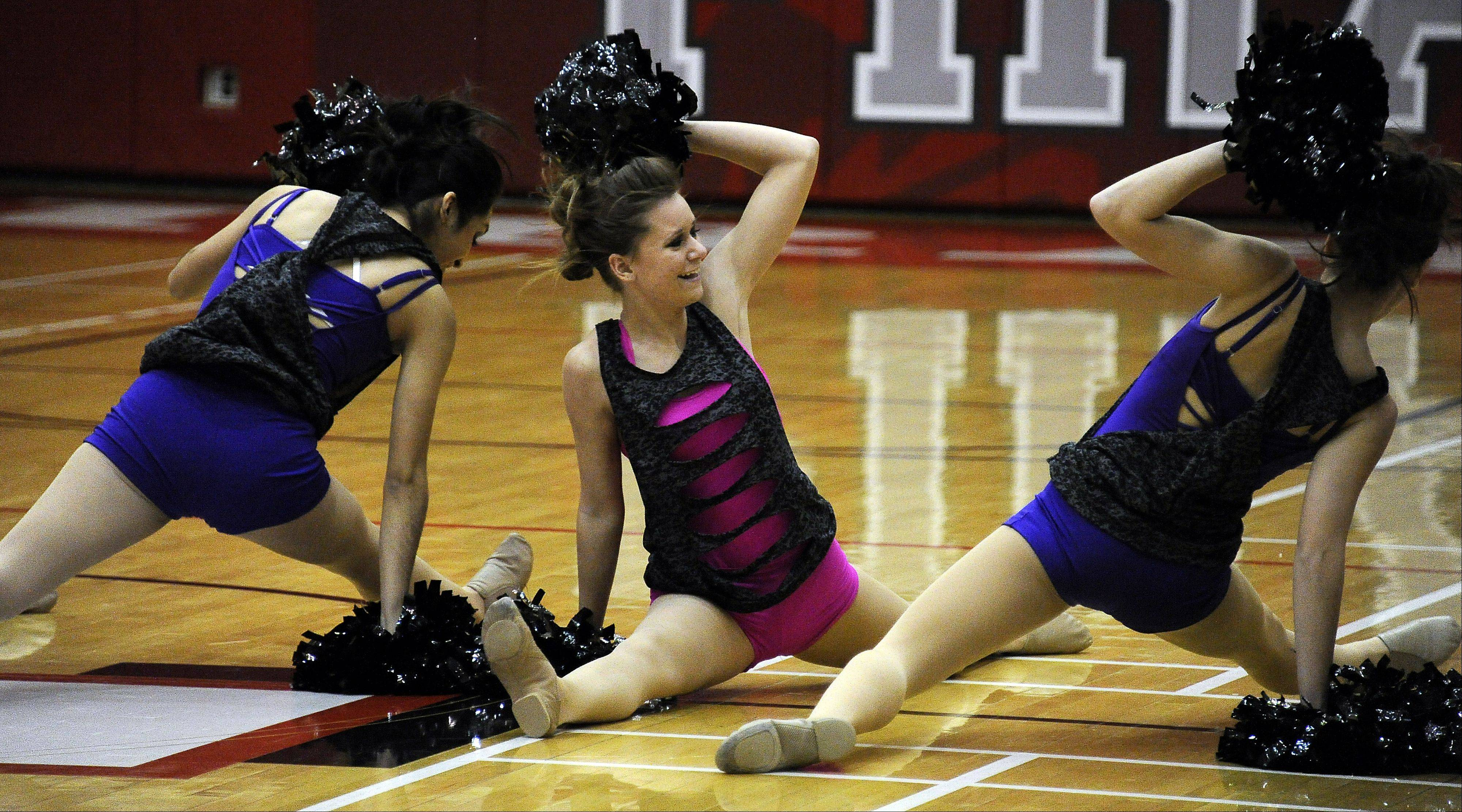 Dancing in the (2A) division are members of Hoffman Estates High School dance squad in front of packed house with Megan Kwiatkowski (center) leading the way in the 1st annual Sectional Competition at Palatine High School on Saturday.