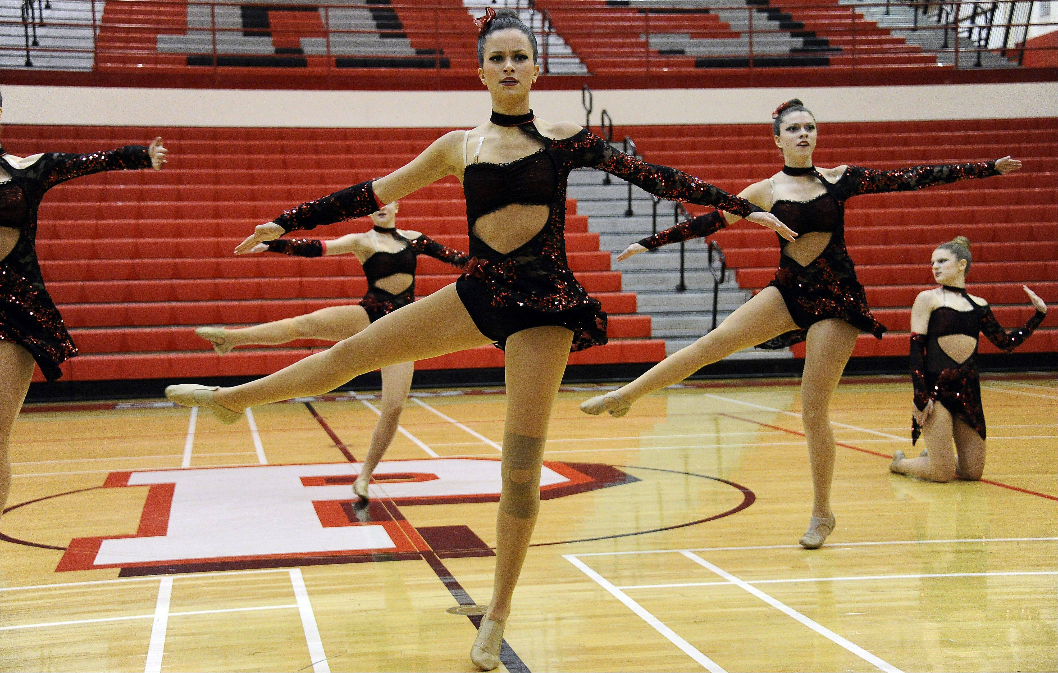 Dancing in the (2A) division are members of St. Charles North High School dance squad with Monique Perdue (center) leading the way in the 1st annual Sectional Competition at Palatine High School on Saturday.