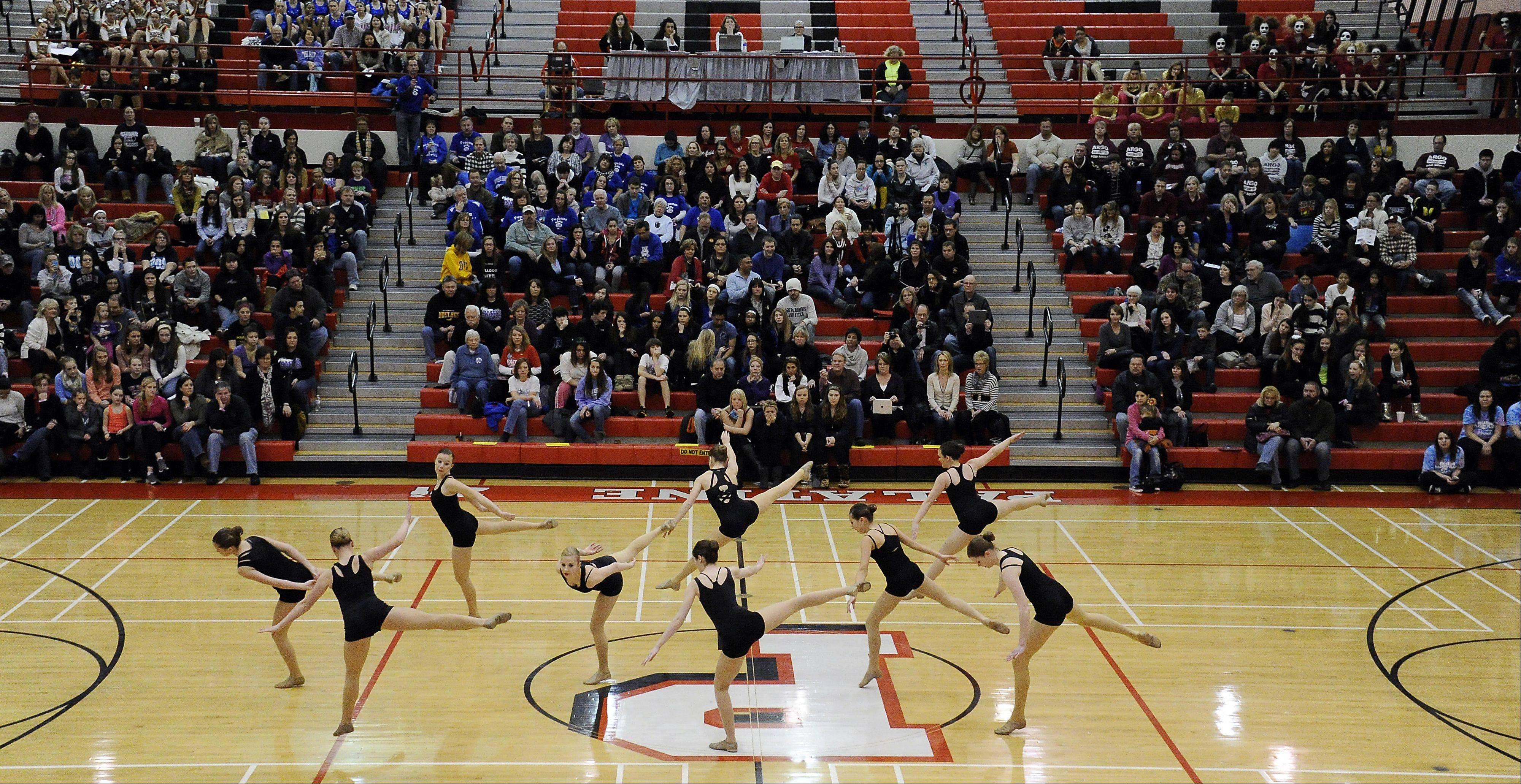 Dancing in the (2A) division are members of St. Viator High School dance squad in front of packed house in the 1st annual Sectional Competition at Palatine High School on Saturday.