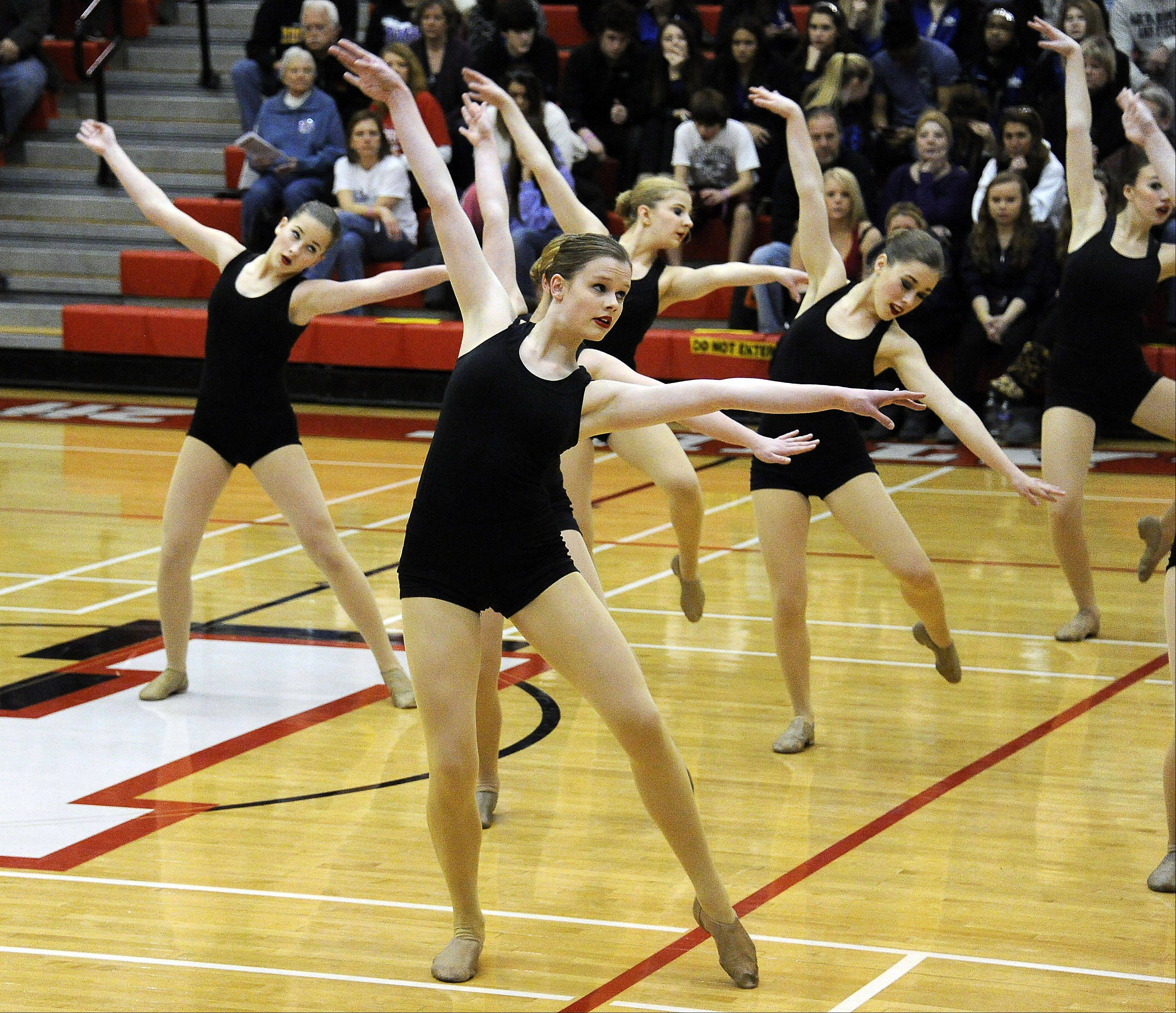 Dancing in the (2A) division are members of St. Viator High School dance squad in front of packed house with Margaret Aichele leading the way in the 1st annual Sectional Competition at Palatine High School on Saturday.