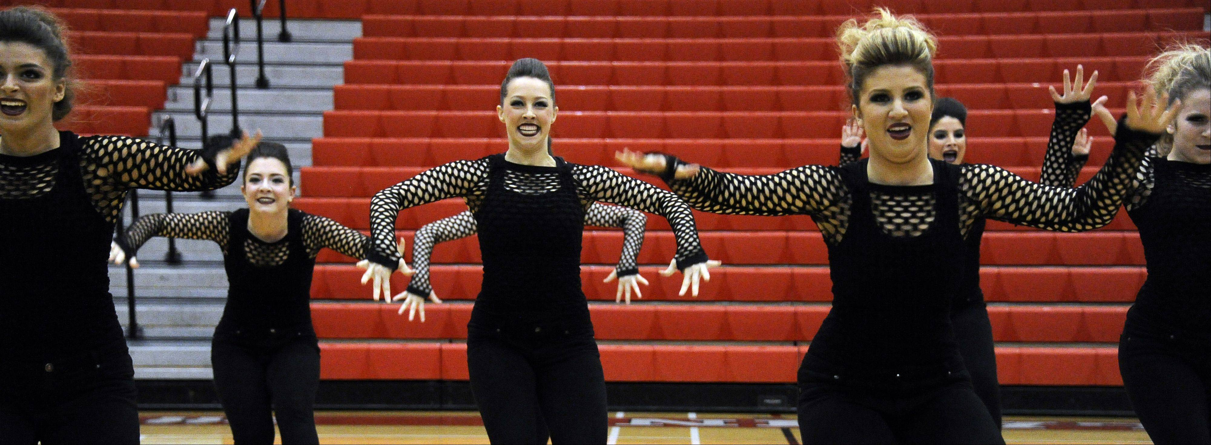 Dancing in the (2A) division are members of Streamwood High School dance squad with Kasey Schomaker (center) leading the way in the 1st annual Sectional Competition at Palatine High School on Saturday.