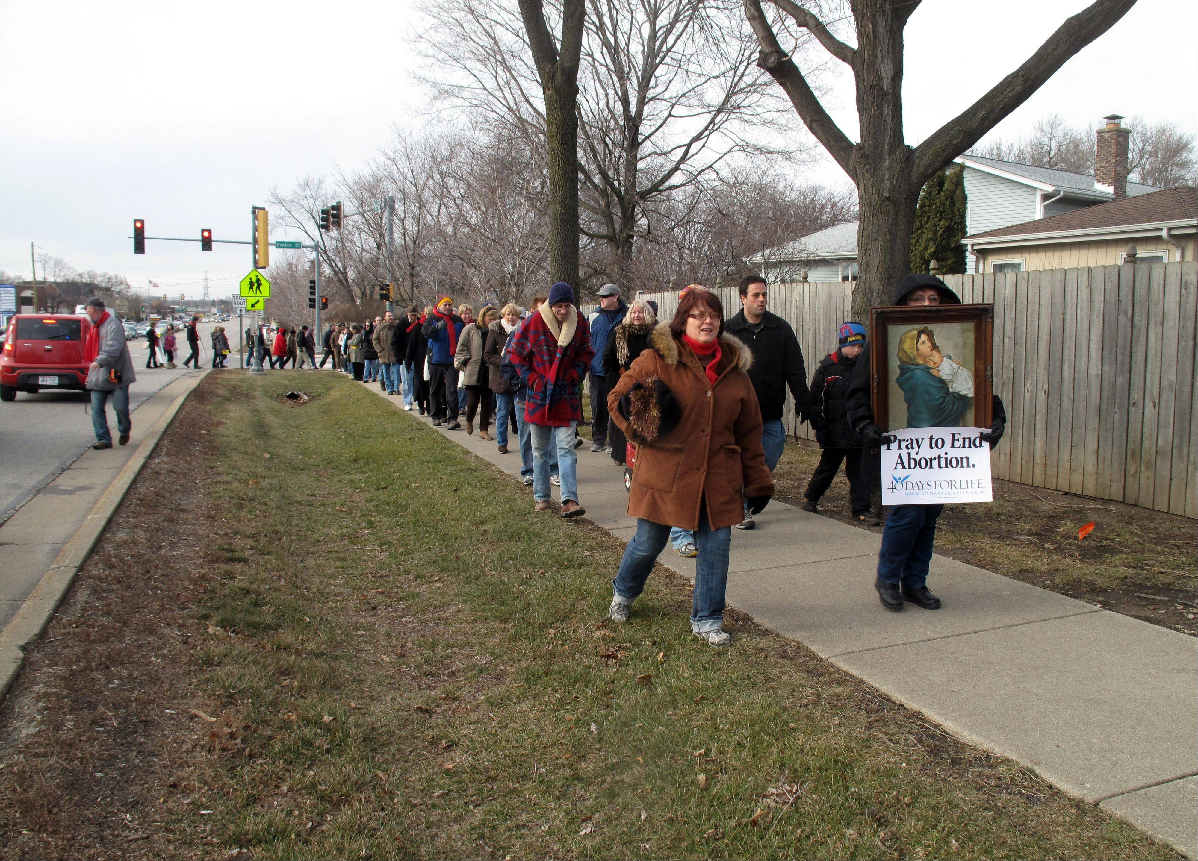 "Participants in Northwest Families for Life's ""March for Life"" on Saturday in Palatine walk along Northwest Highway from St. Theresa Parish to the plaza at Northwest Highway and Hicks Road. The march drew about 400 anti-abortion activists."