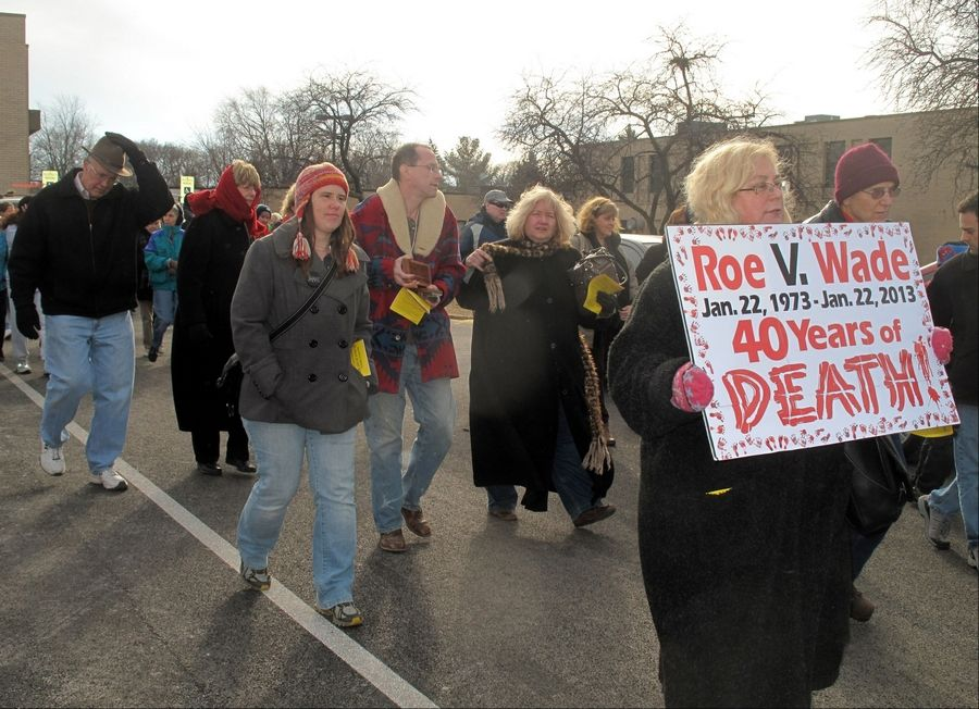 "Marchers in Northwest Families for Life's ""March for Life"" leave St. Theresa Parish in Palatine on Saturday afternoon, heading for a plaza at Northwest Highway and Hicks Road."
