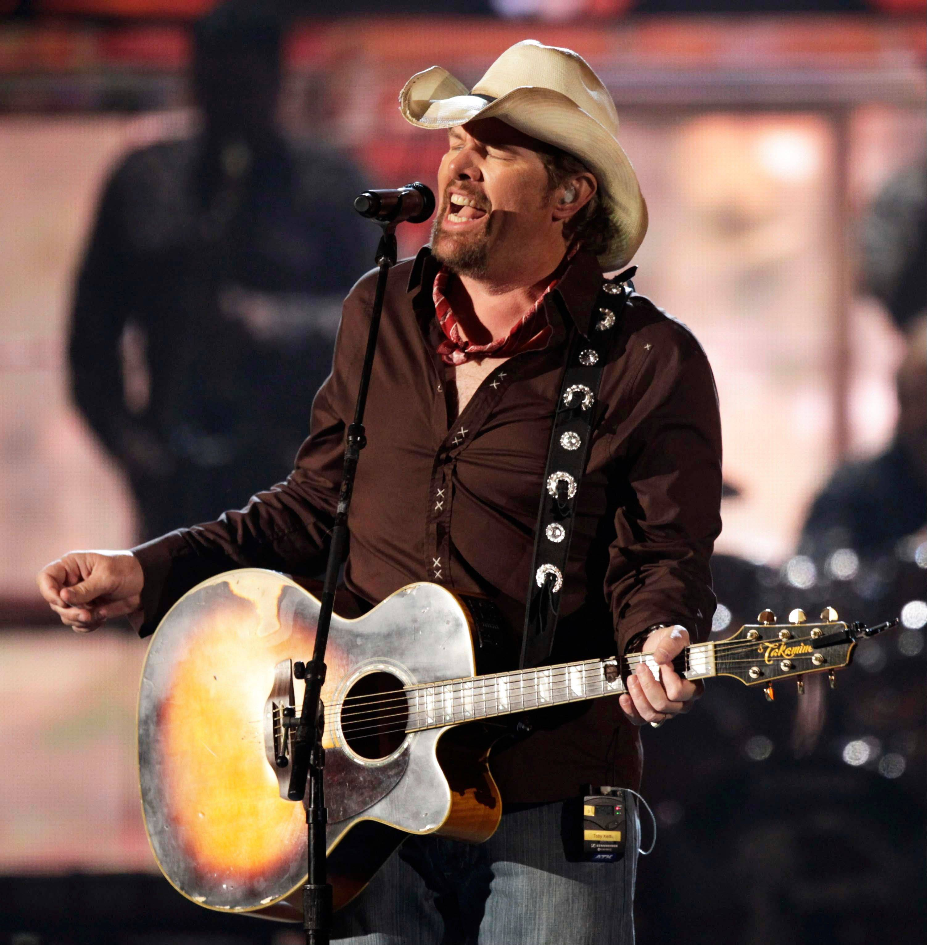 In this April 3, 2011 file photo, country singer Toby Keith performs at the 46th Annual Academy of Country Music Awards in Las Vegas. Tickets for Keith's performance at the state fair go on sale on Feb. 9.