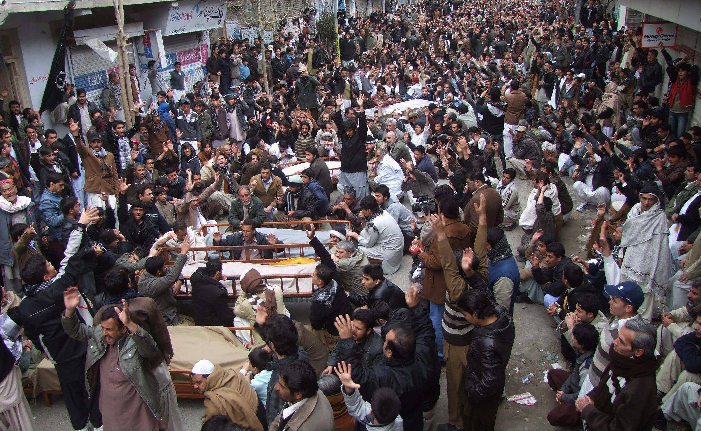 About 1,000 Pakistani Shiites blocked a main road Jan. 12 in Quetta, Pakistan, with dozens of coffin to demand better security from the government.