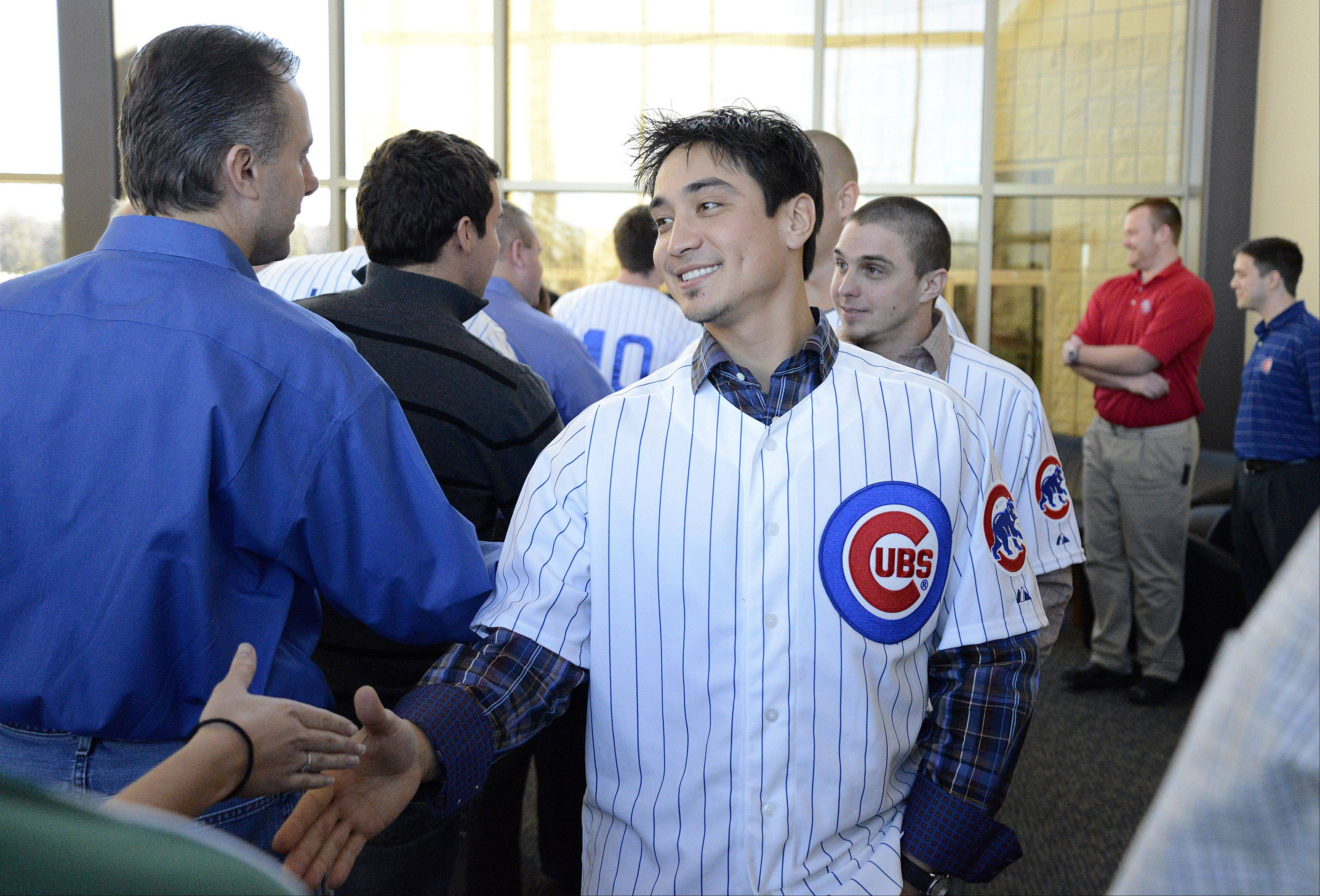 Chicago Cubs second baseman and 2012 Gold Glove winner Darwin Barney, followed by outfielder Tony Campana, meet staff members of the Kane County Cougars during a quick visit at Fifth Third Bank Ballpark in Geneva Jan. 17. Players, coaches and staff of the Cubs On the Move 2013 Caravan Tour came by for about 30 minutes after meeting with children at an Oswego school.