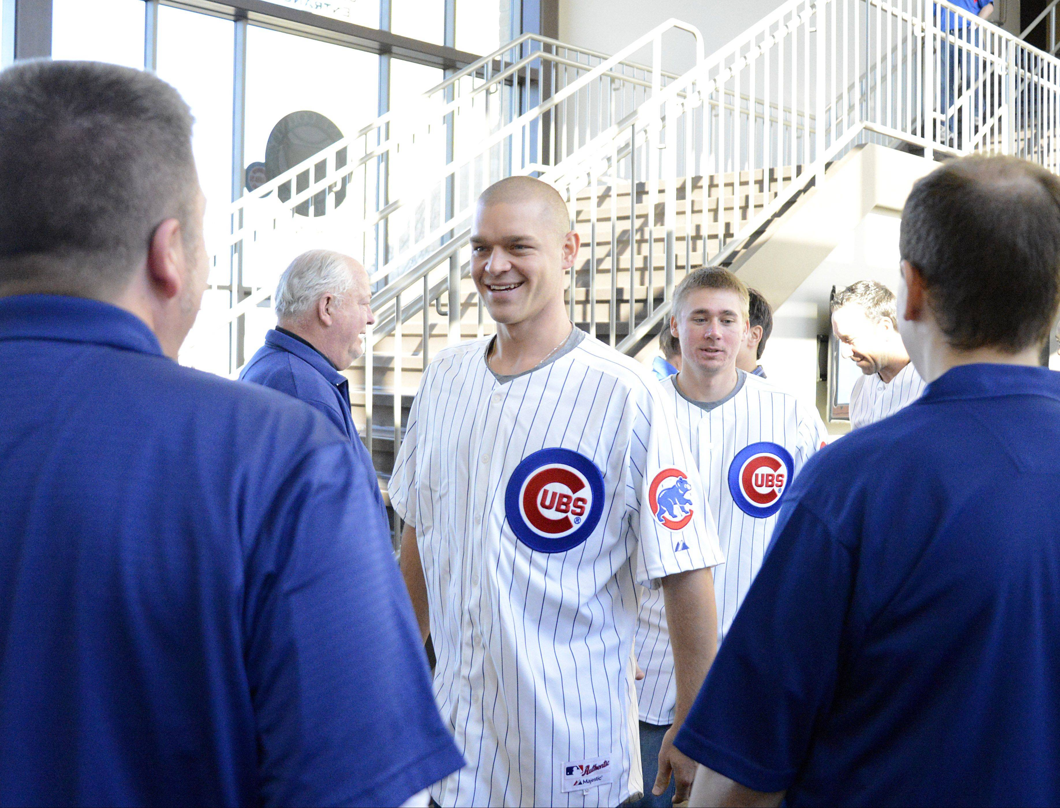 Kane County Cougars General Manager Curtis Haug, left, and Director of Public Relations Shawn Touney meet Chicago Cubs pitcher Michael Bowden at Fifth Third Bank Ball Park in Geneva Jan. 17. The Cougars are now a Class A affiliate with the Chicago Cubs.