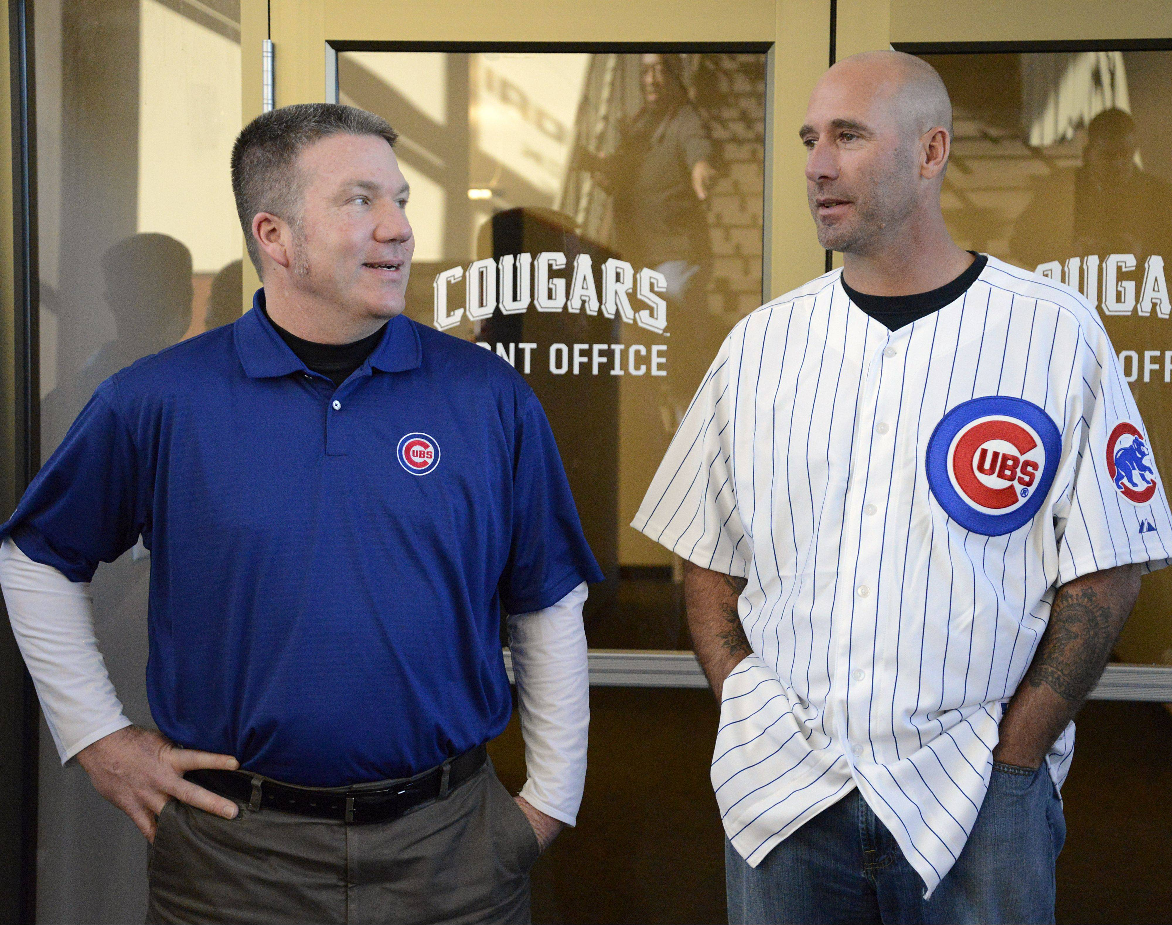 Kane County Cougars general manager Curtis Haug, left, and Chicago Cubs manager Dale Sveum chat during a visit between stops on theCubs On the Move 2013 Caravan Tour in Geneva Jan. 17. Players, coaches and staff of the Chicago Cubs Cubs On the Move 2013 Caravan Tour came by after meeting with children at an Oswego school.