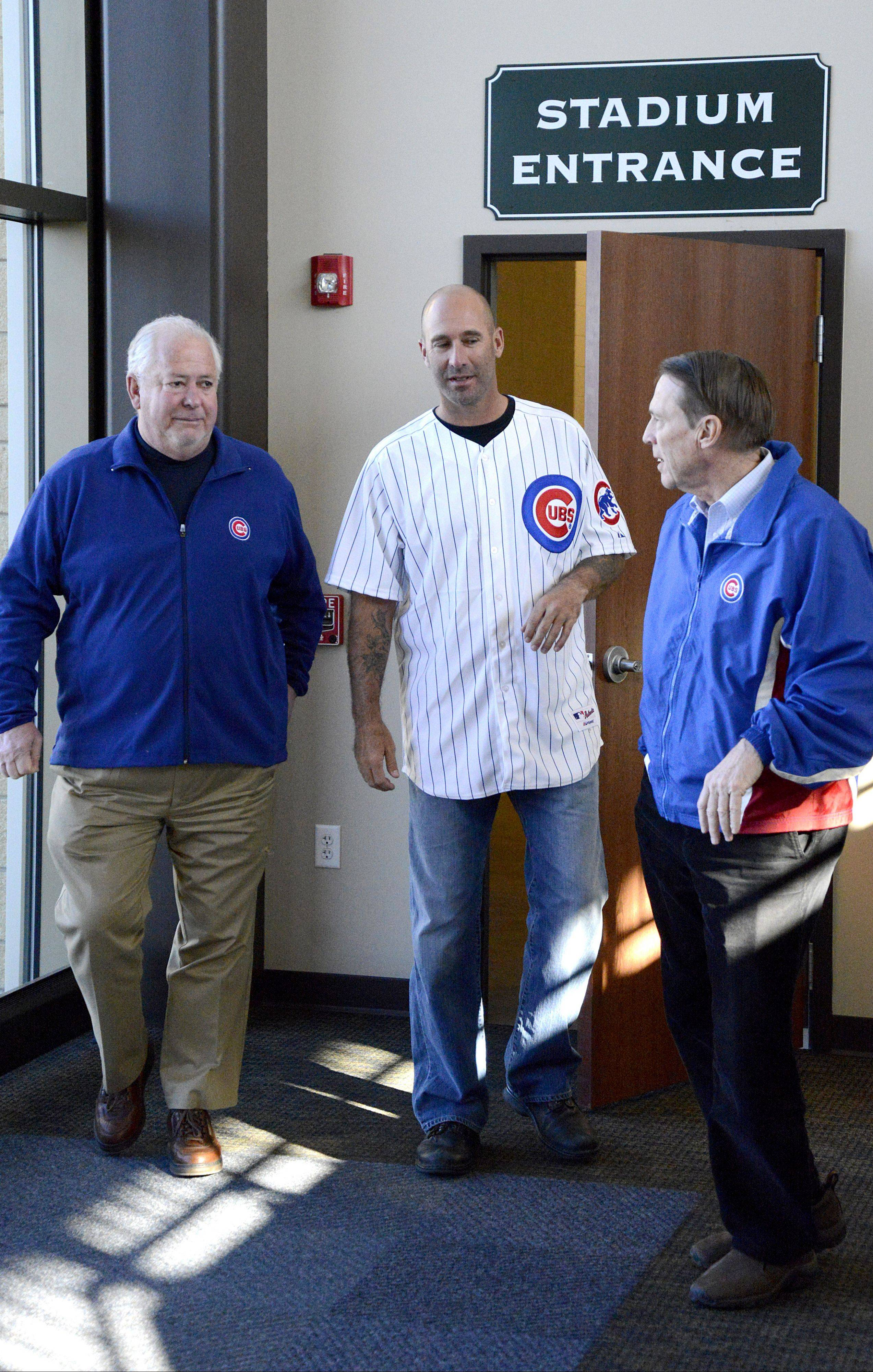 Kane County Cougars Managing Partners Mike Woleben, left, and Mike Murtaugh, right, gave Cubs manager Dave Sveum a quick peek at the stadium.