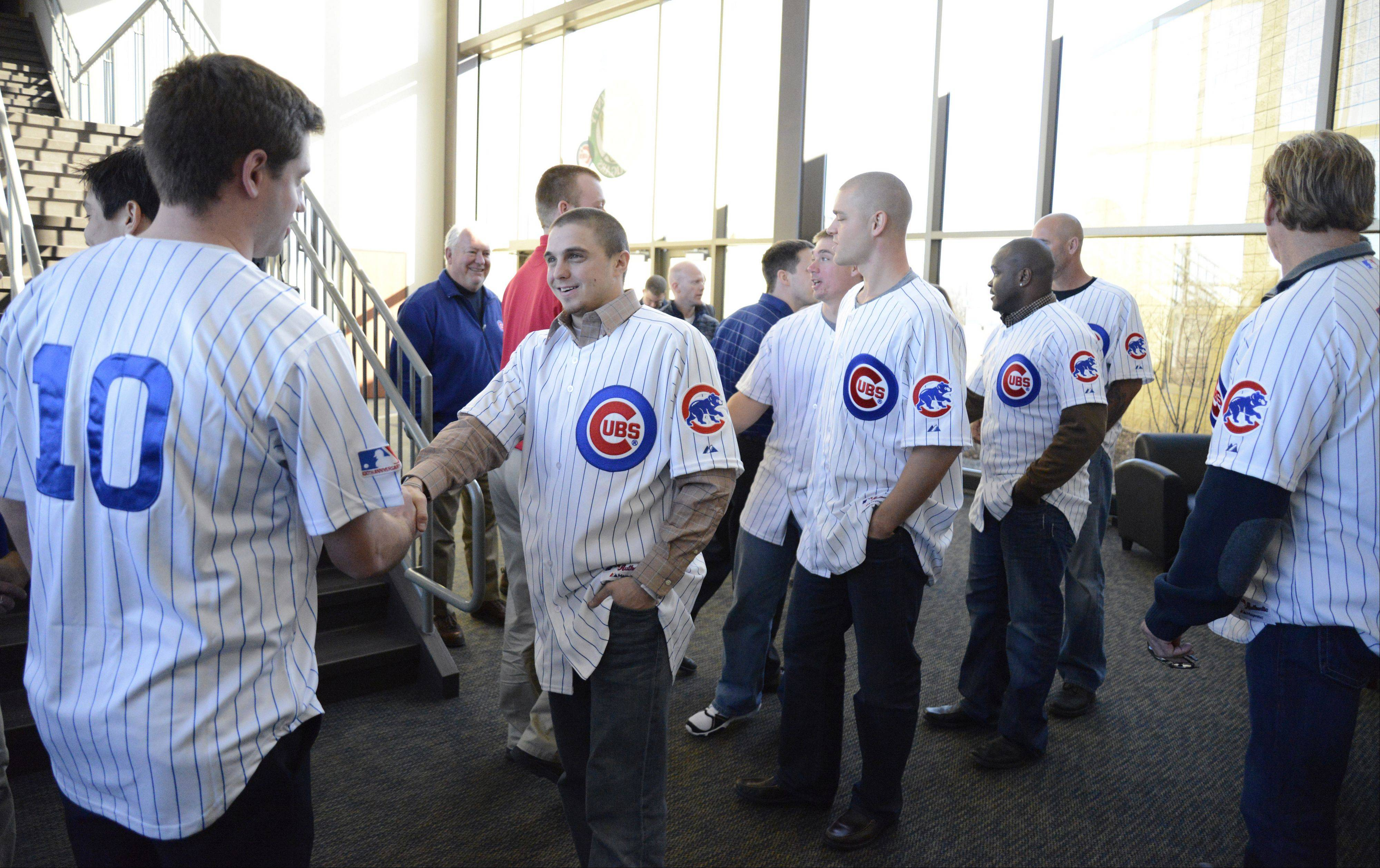 Chicago Cubs outfielder Tony Campana, followed by pitcher Michael Bowden, meet staff members of the Kane County Cougars during a visit to Fifth Third Bank Ball Park in Geneva Jan. 17. The Cougars are now a Class A affiliate with the Chicago Cubs.
