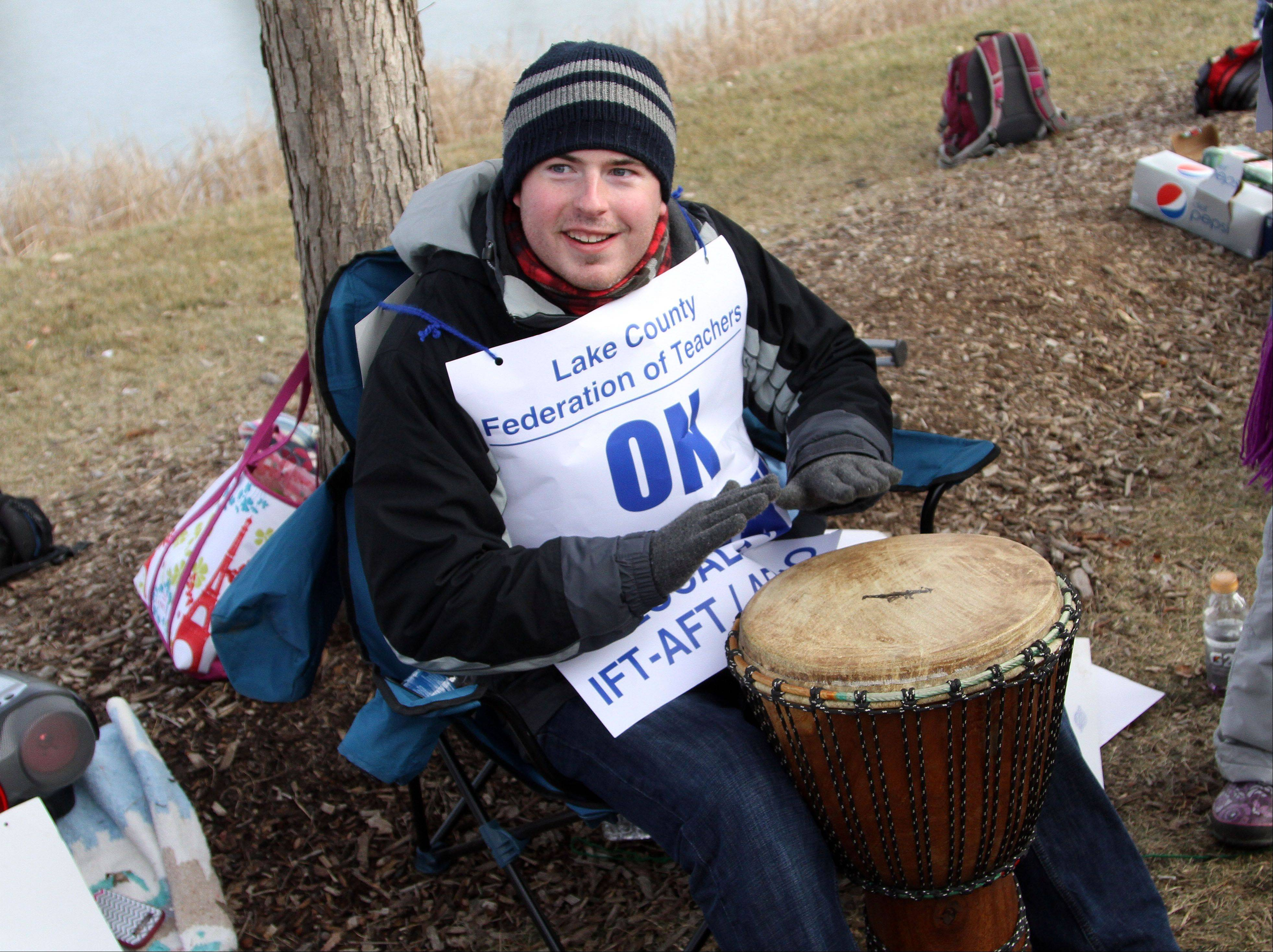 Sixth-grade teacher Jason White was among the District 46 teachers picketing Friday in front of Frederick School in Grayslake.