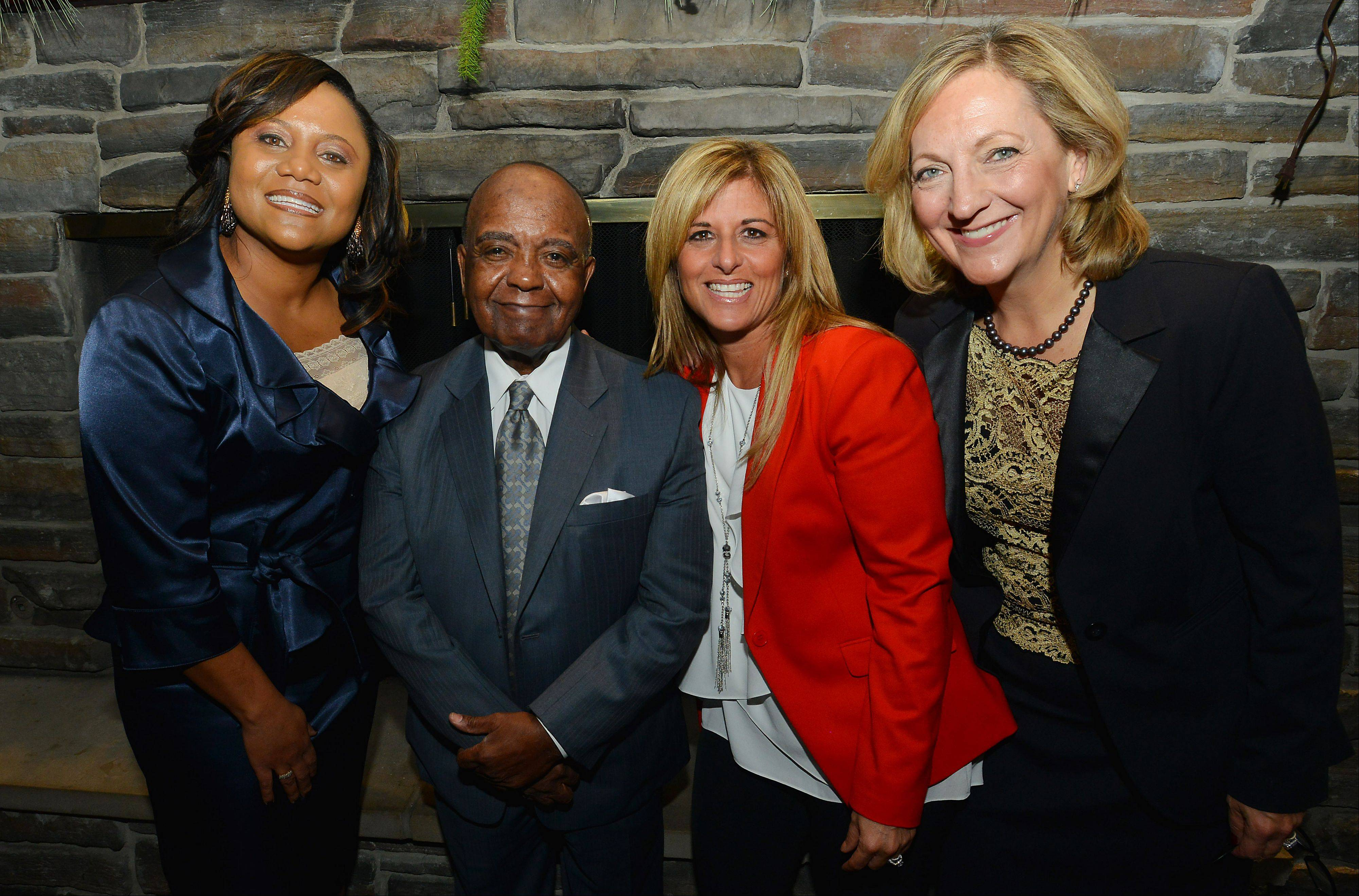 Three women were honored at the 12th annual Martin Luther King Jr. remembrance dinner in Hoffman Estates. Pictured with the Rev. Clyde Brooks, president of the Illinois Commission on Diversity and Human Relations, are, from left, keynote speaker Toni Carter of Motorola Solutions, Sherry Noland-Schultz of Sears Holdings Co. and attorney Kay Hoogland.