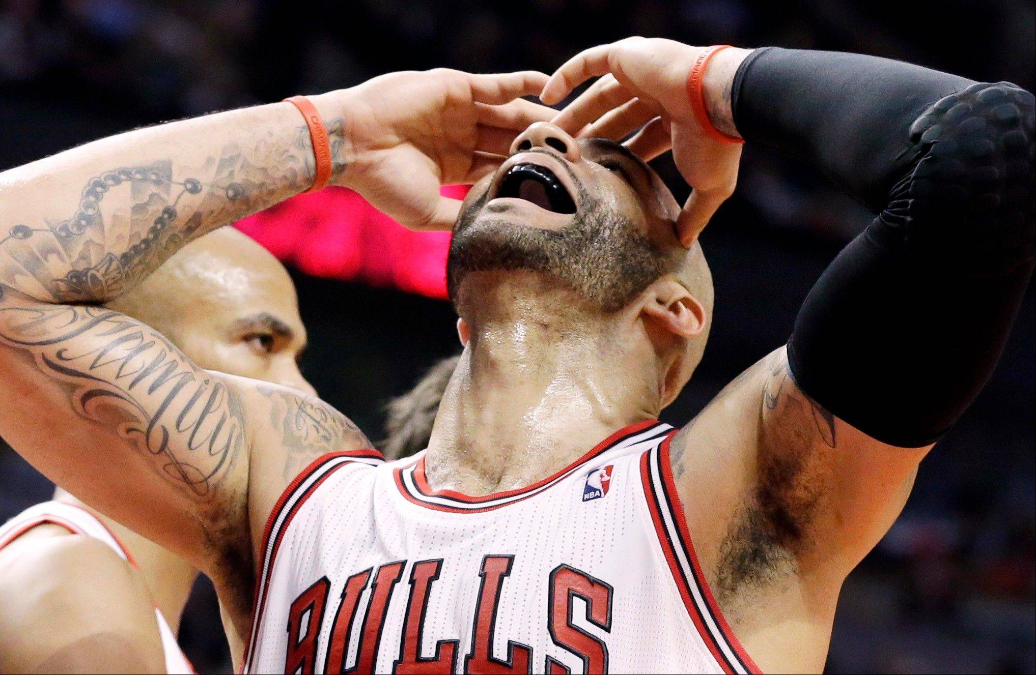 Bulls forward Carlos Boozer reacts after missing a basket during Saturday night's loss to Memphis at the United Center.