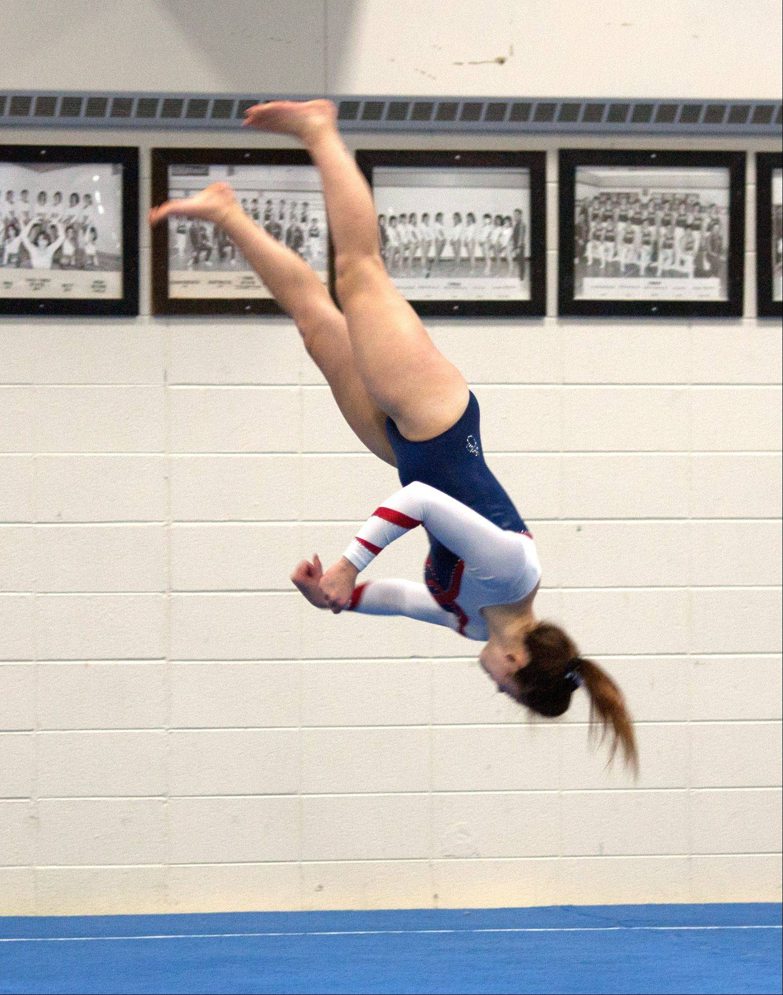 Conant's Meicie Bennett performs her floor exercise routine during the York Community High School Girls' Gymnastics Invite.
