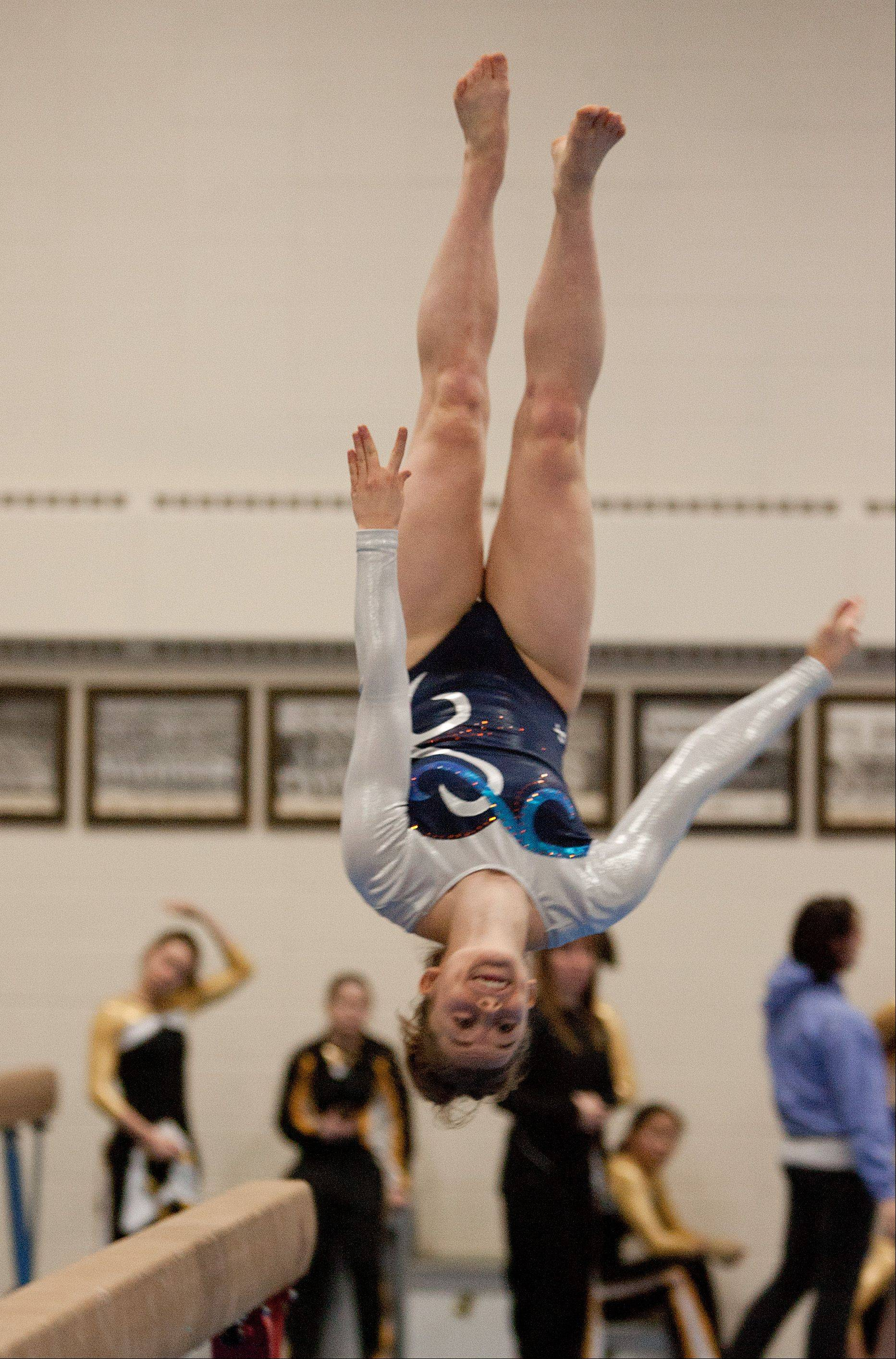 Naperville North High School's Kaitlyn Daly performs her balance beam routine, during the York Girls' Gymnastics Invite.