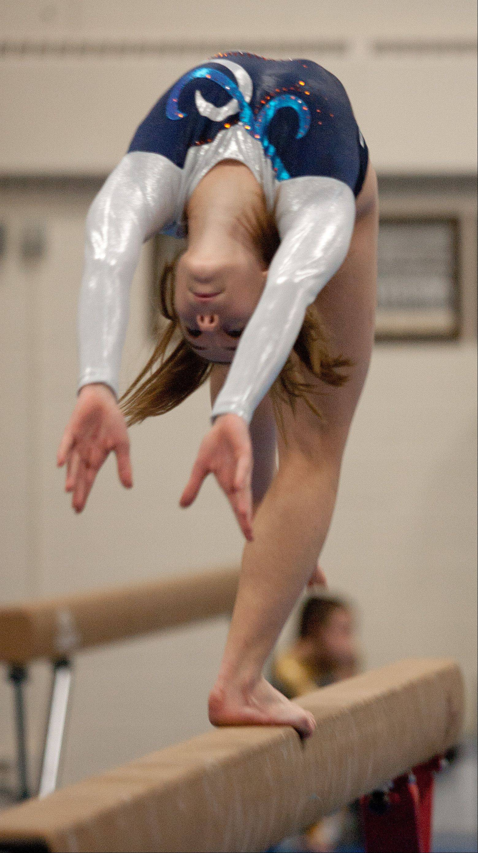 Naperville North High School's Stephanie Mueller performs her balance beam routine, during the York Girls' Gymnastics Invite.