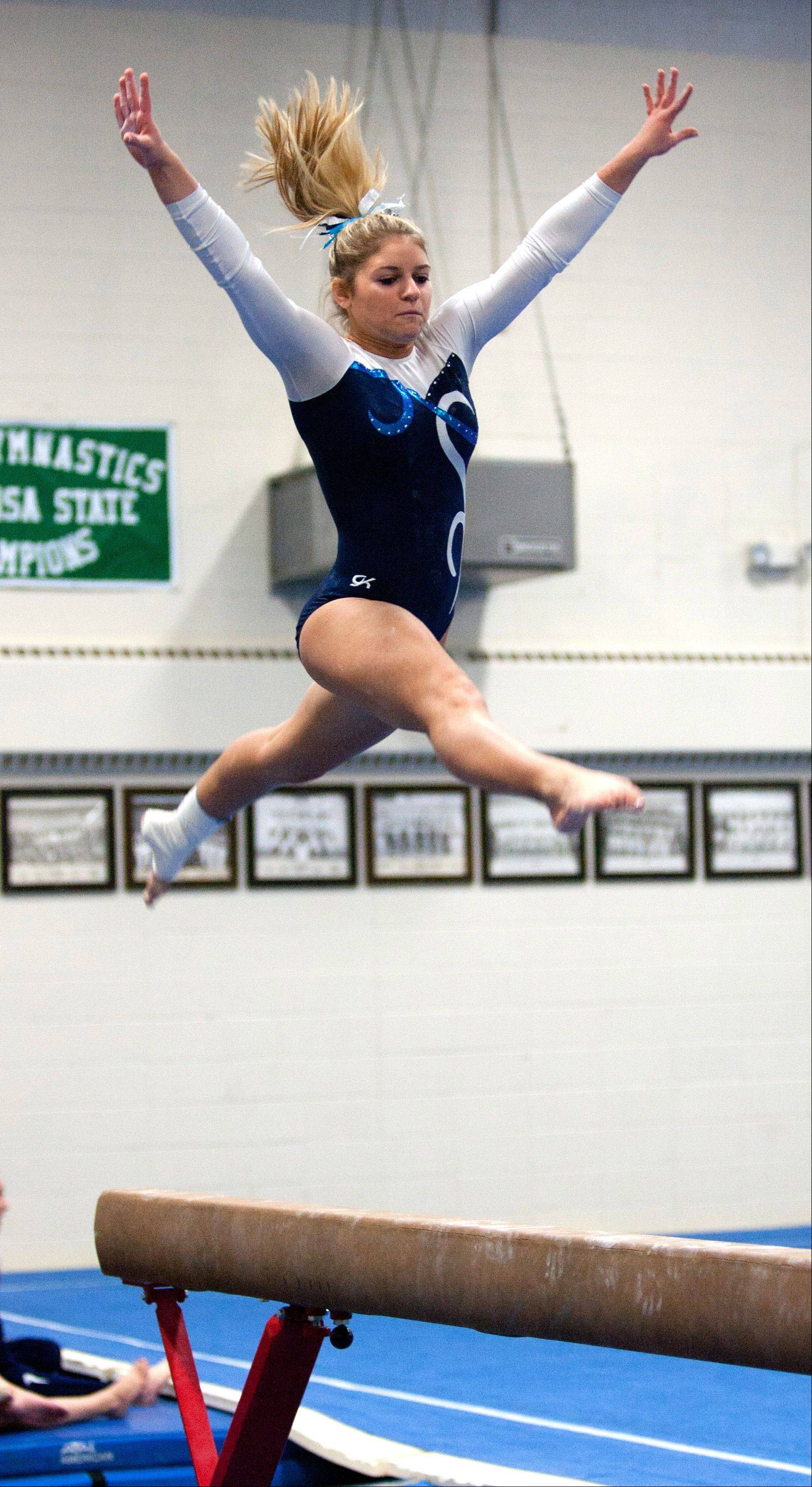 Lake Park High School's Annalise Donati performs her balance beam routine, during the York Girls' Gymnastics Invite.