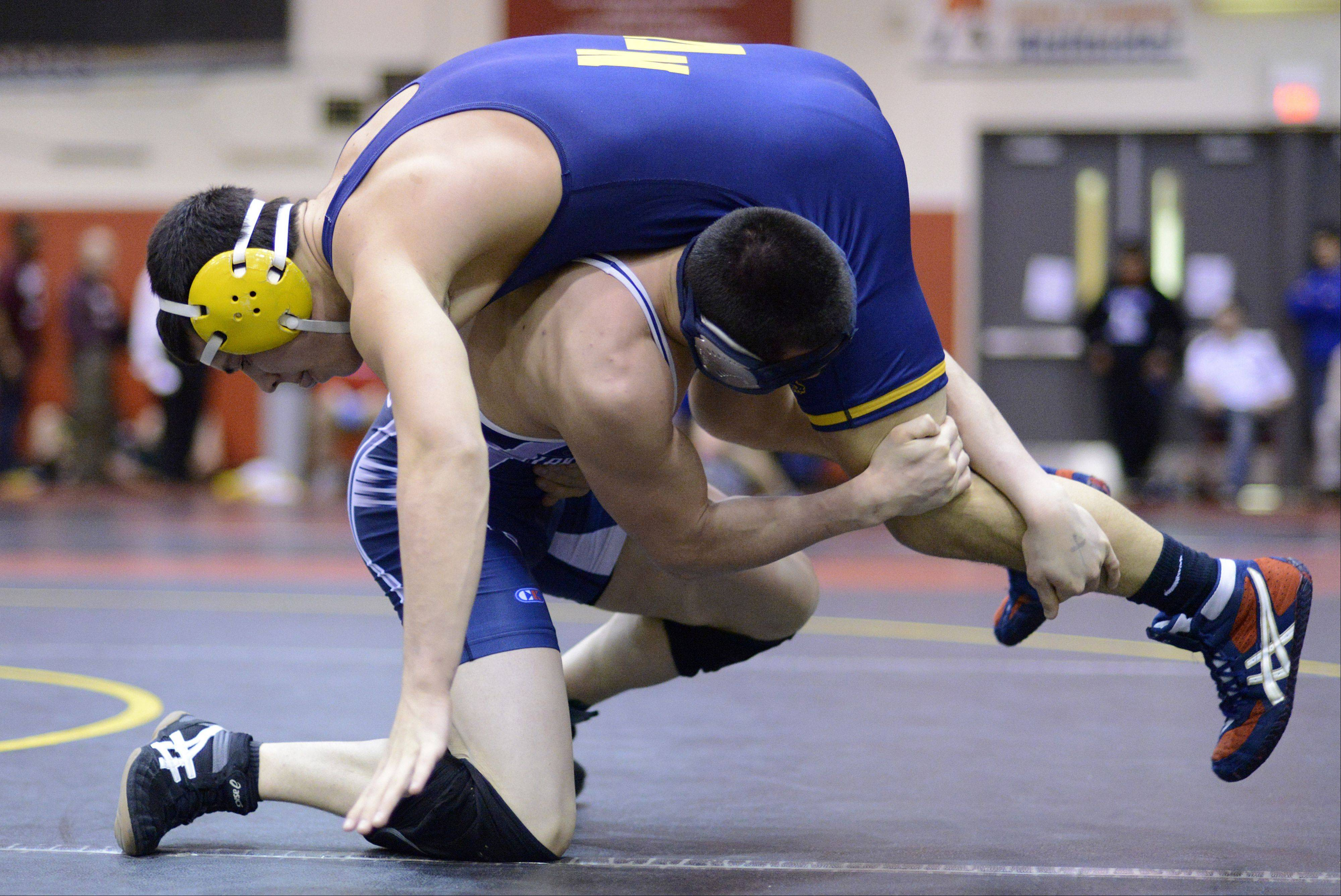 Neuqua Valley's Brent Lindenman and Lake Park's Henry Stoever in the 170-pound match of the semifinals in the Upstate Eight mega conference on Saturday, January 19. Stoever took the win.