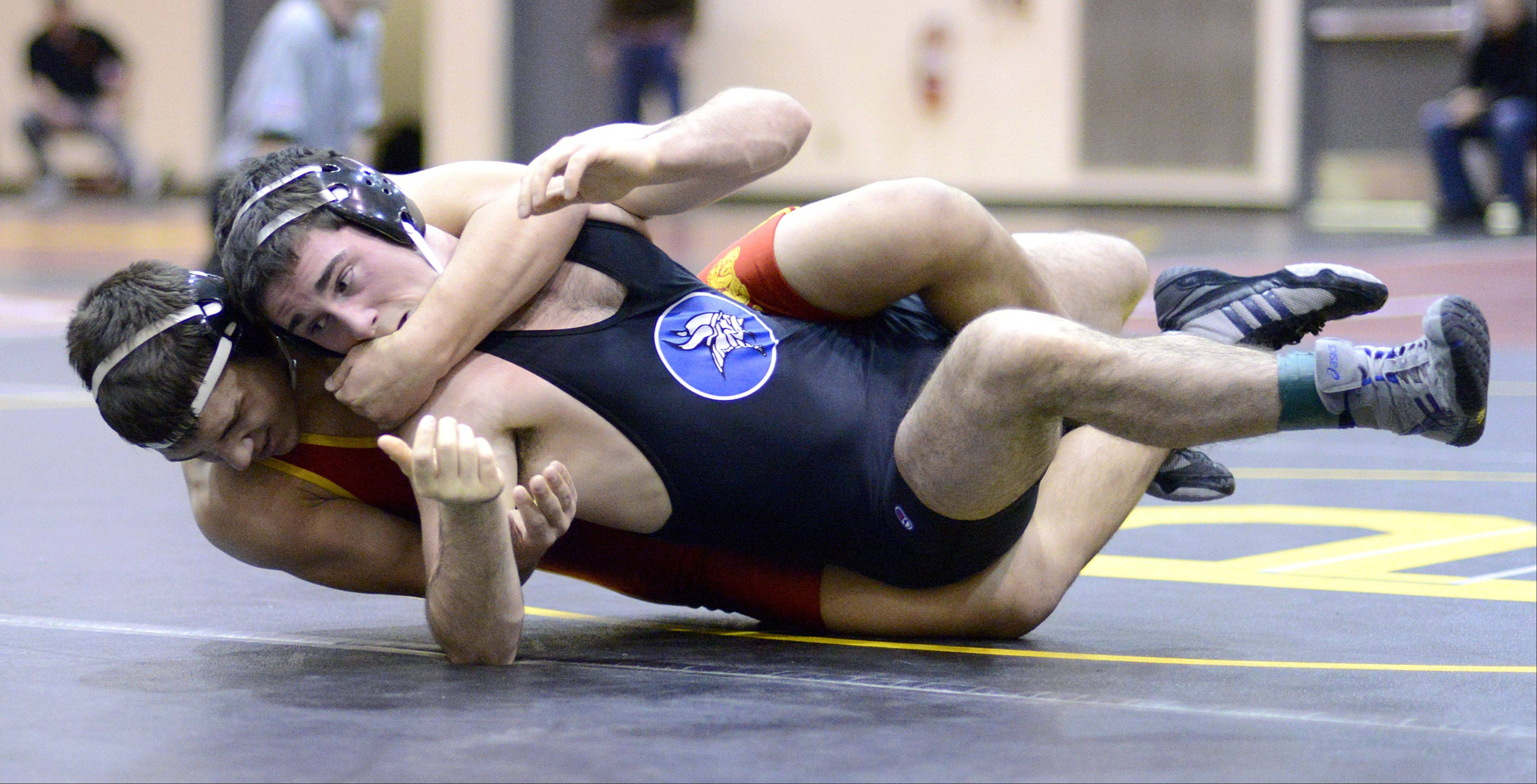 Batavia's Jon Wagner wraps up Geneva's Alex Kunkel in the 160-pound semifinals match at the Upstate Eight mega conference on Saturday, January 19.