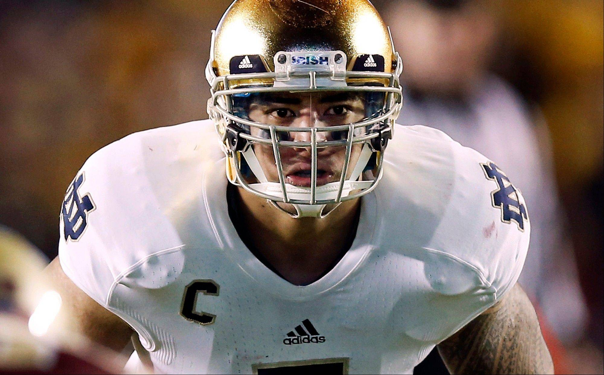 In this Nov. 10, 2012, file photo, Notre Dame linebacker Manti Te'o waits for the snap during the second half of their NCAA college football game against Boston College in Boston.