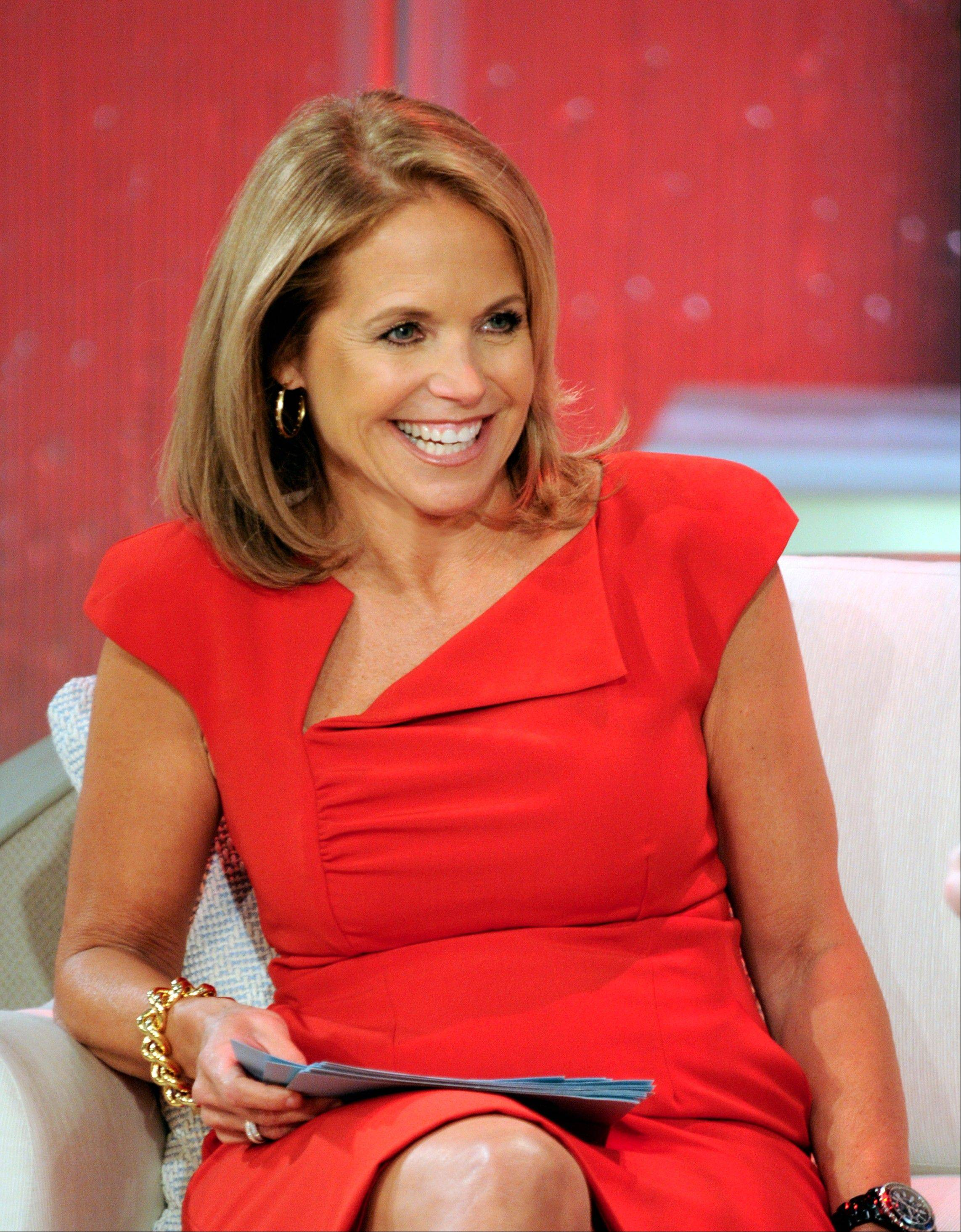 "This Aug. 9, 2012 photo released by Disney-ABC Domestic Television shows host Katie Couric during a taping of her new talk show ""Katie."" Couric's has landed the first on-camera interview with Notre Dame linebacker Manti Te'o."