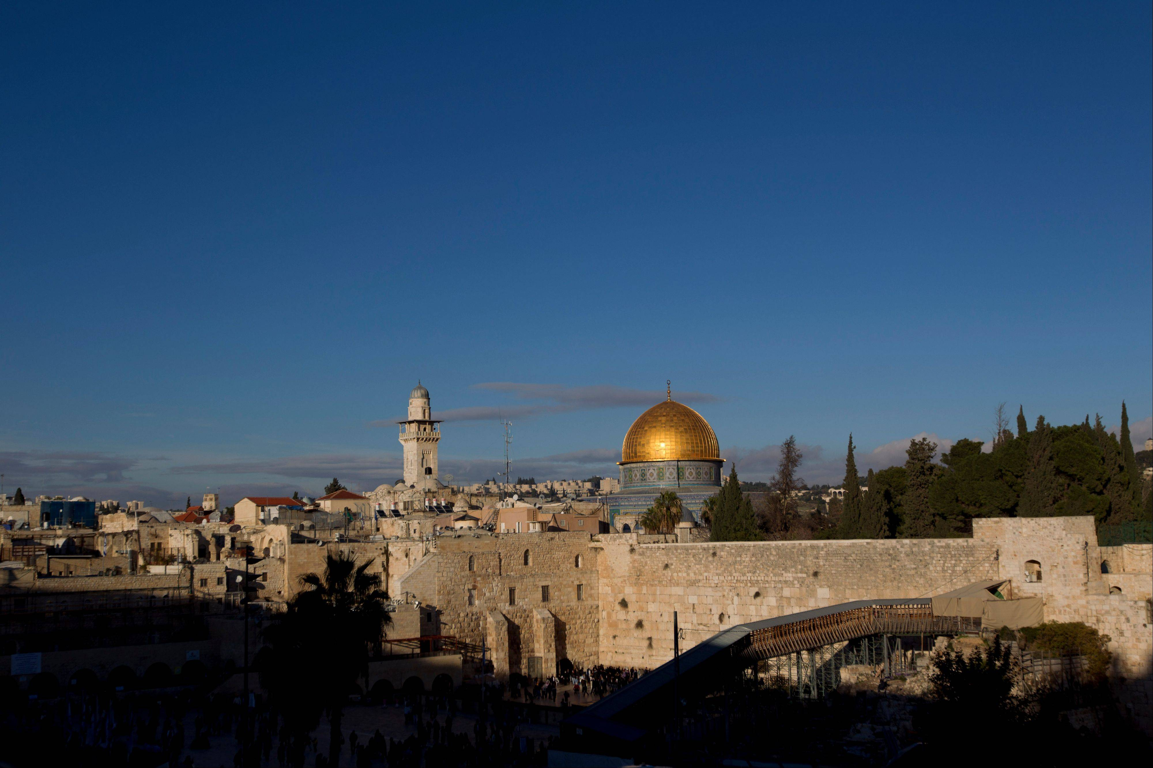 The Western Wall and golden Dome of the Rock in Jerusalem's Old City.