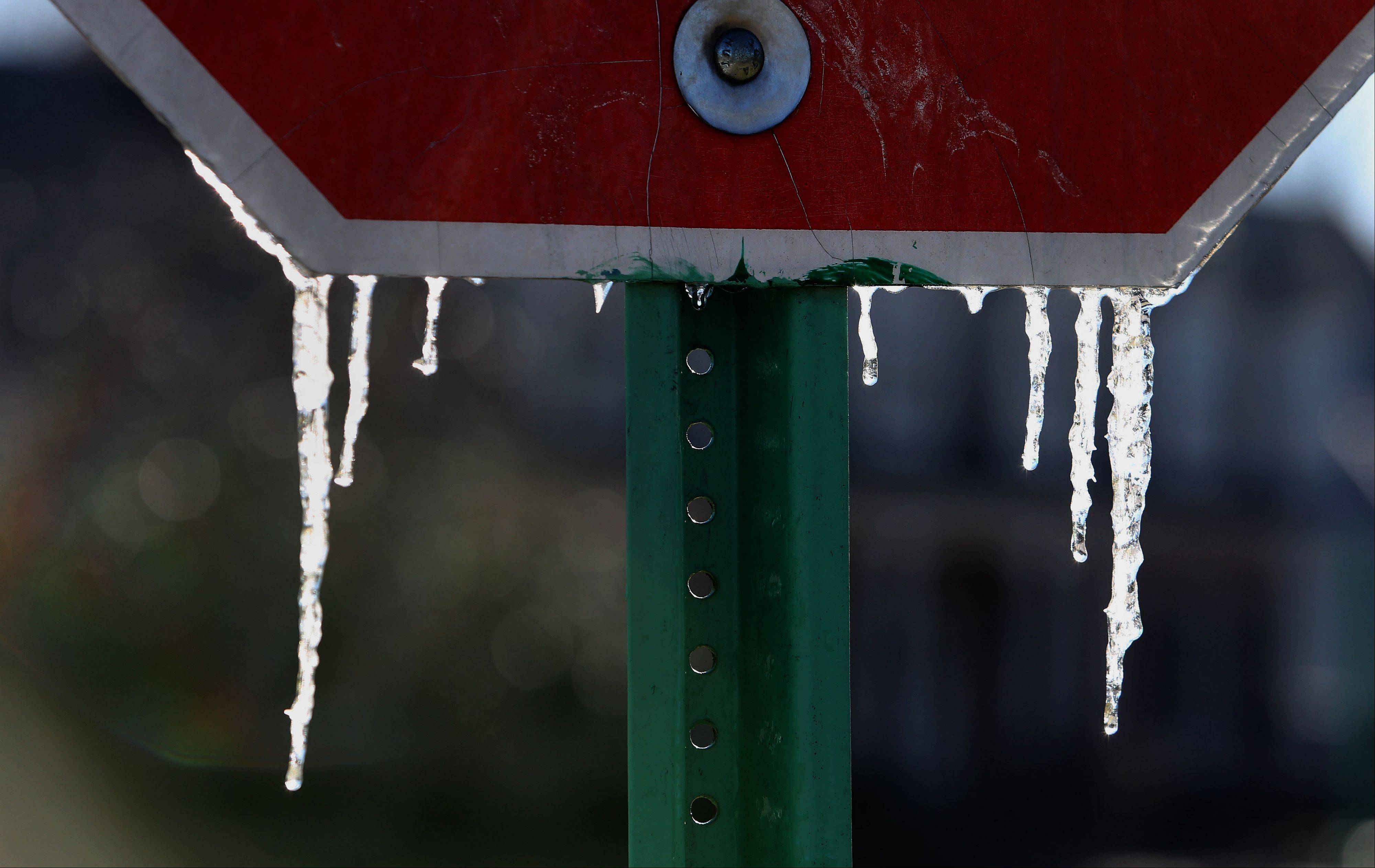 Icicles dangle from a stop sign in Wheaton after temperatures plunged into the single digits Monday.
