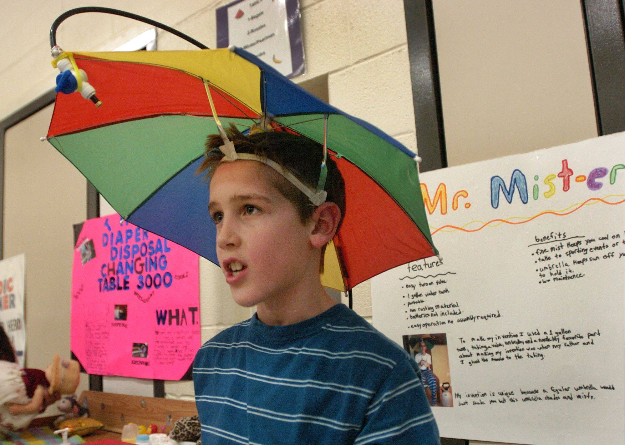 "Jonathan Hales demonstrates his ""Mr. Mist-er,"" designed to help keep you cool in the summer, during the 5th grade Invention Convention at Robert Crown School in Wauconda."