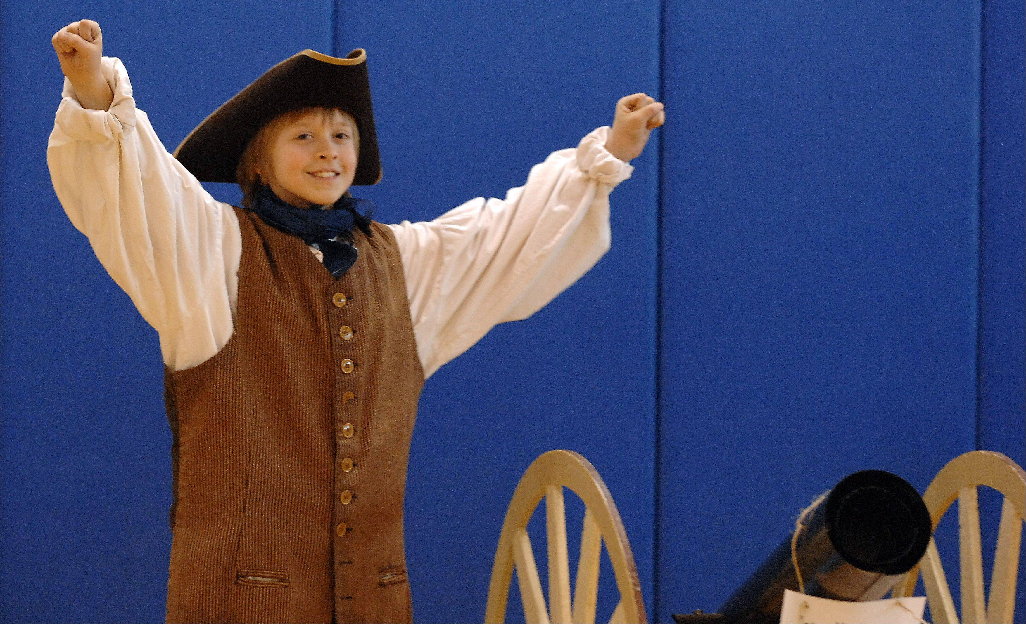 Logan Hunter throws his hands up after his cannon was named a winner for being the most realistic replica in the colonial tournamnet during the annual Patriots Day event at Geneva Middle School North Friday.