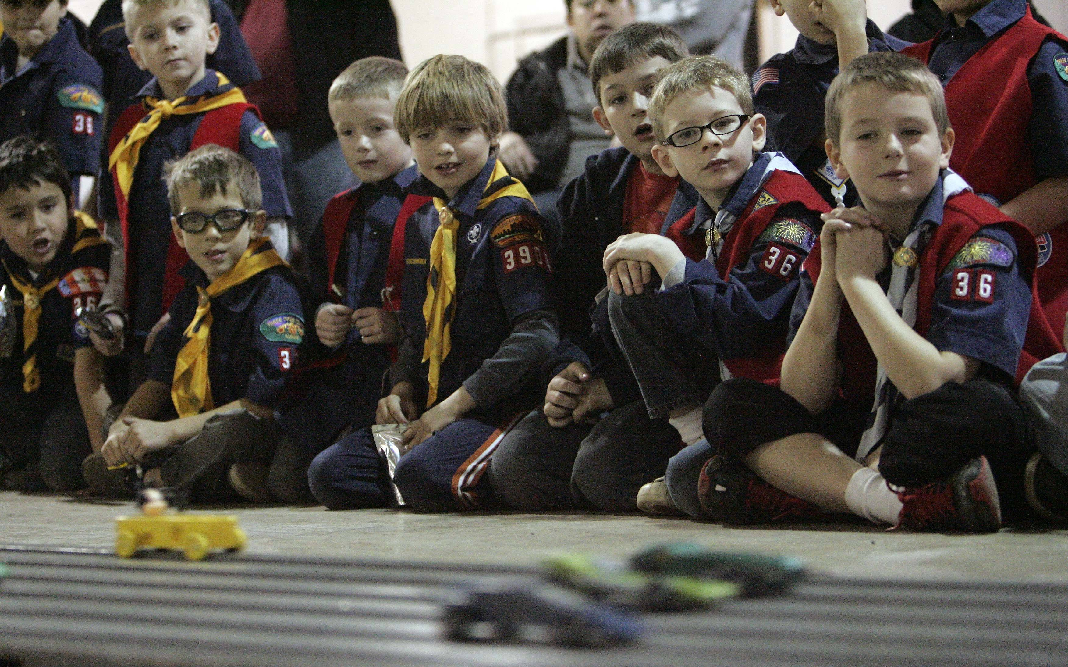 Scouts watch as some of the first races get underway as Cub Scout Pack 36, of West Dundee holds their pinewood derby Saturday at Spring Hill Ford in East Dundee.
