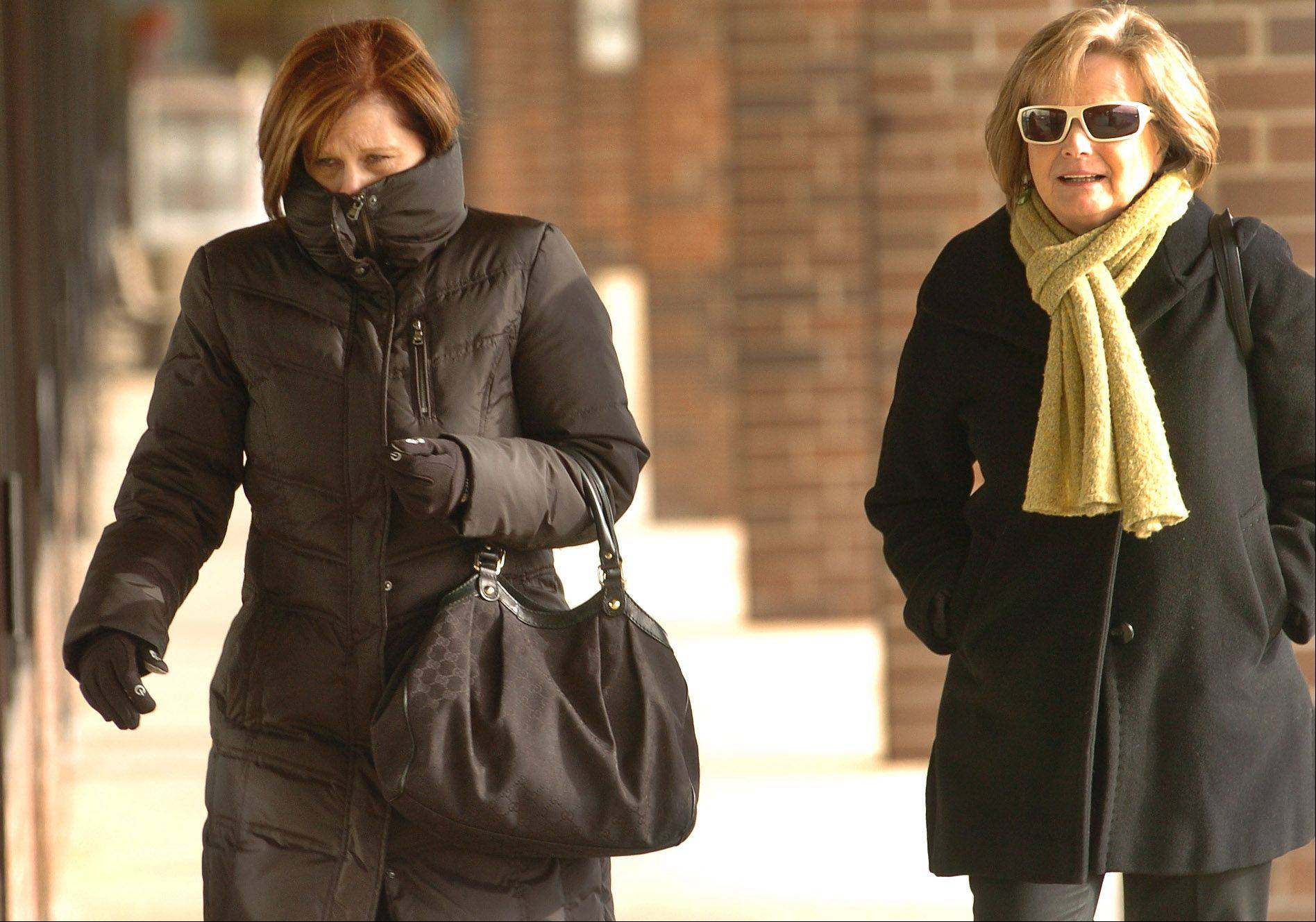 Judy Anglada, left, and Jeanne Derrig brave the cold on their way to lunch at Elk Crossings in Elk Grove Village.