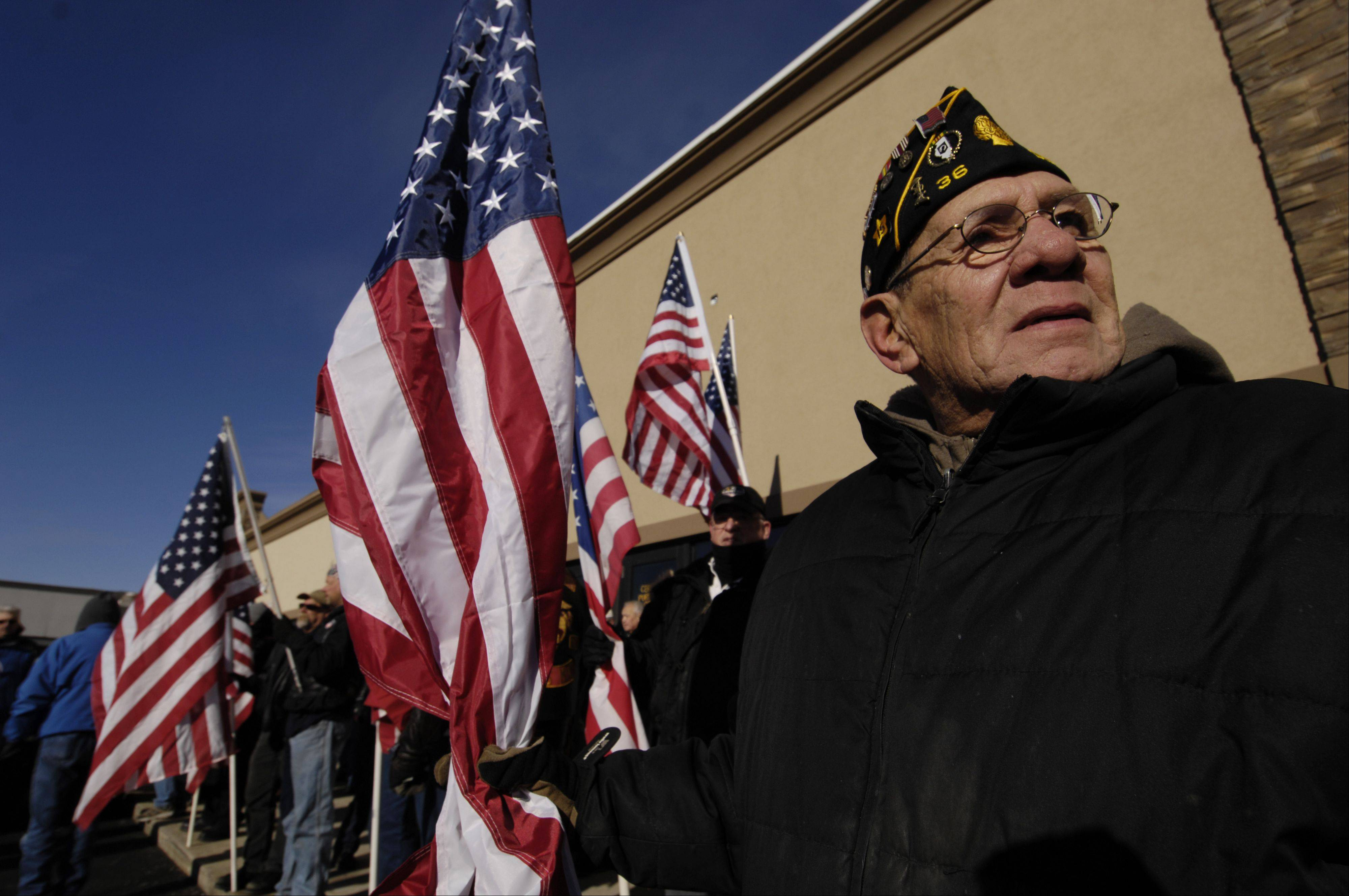 Chuck Campos of Des Plaines American Legion Post 36 stands with other supporters of Glendale Heights VFW Post 2377 Sunday.