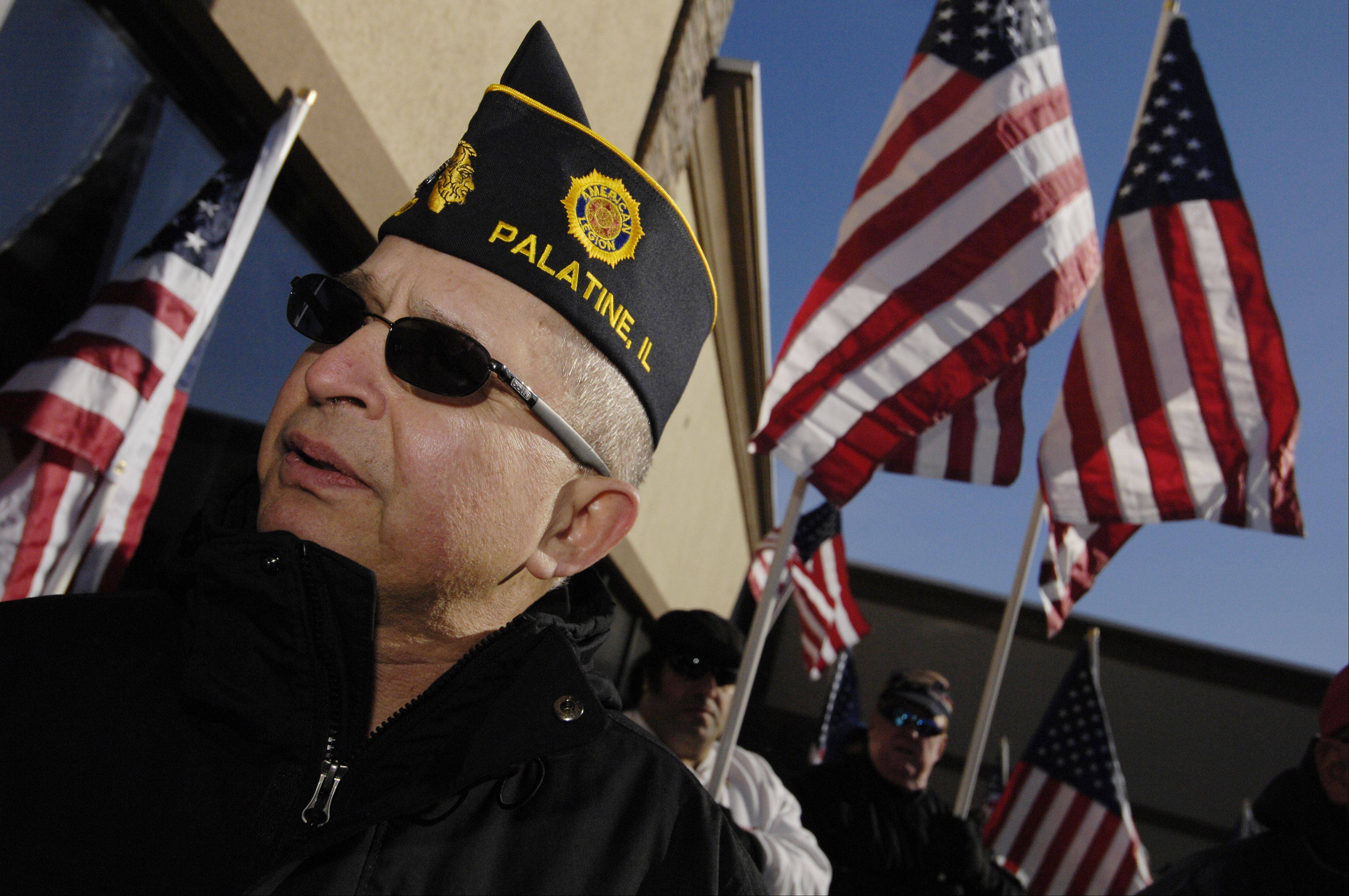 Roman Golash, a retired U.S. Army colonel who is now a member of Palatine American Legion Post 690, joins a rally Sunday in support of Glendale Heights VFW Post 2377.