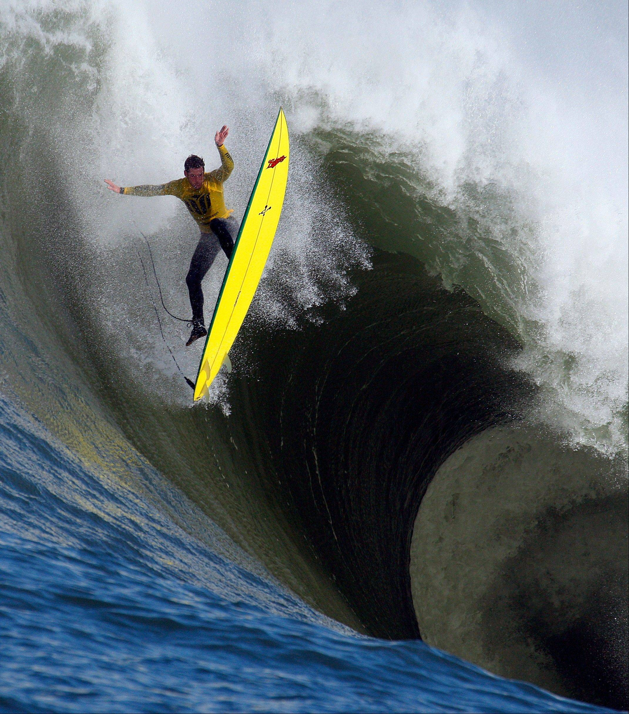In this file photo from Saturday, Feb. 13, 2010, Ion Banner loses control on a giant wave during the Mavericks surfing contest in Half Moon Bay, Calif. As massive swells lumber across the Pacific toward Northern California, nearly two dozen of the world's best big wave surfers will be waiting to meet them Sunday, Jan. 20, 2013, a half-mile offshore at the infamous surfing break Mavericks.