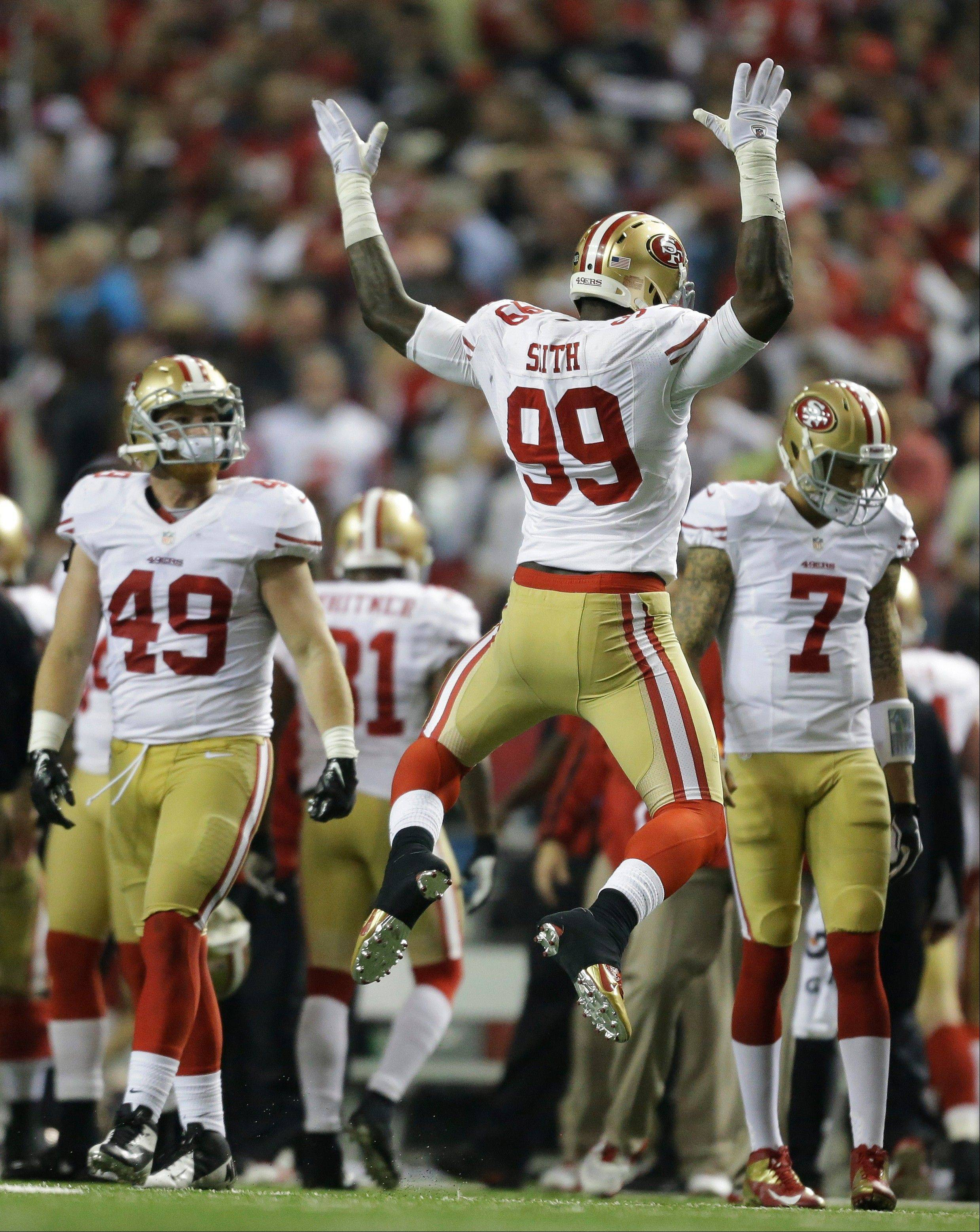 San Francisco 49ers defender Aldon Smith reacts after recovering a fumble during the second half of the NFL football NFC Championship game against the Atlanta Falcons Sunday, Jan. 20, 2013, in Atlanta.