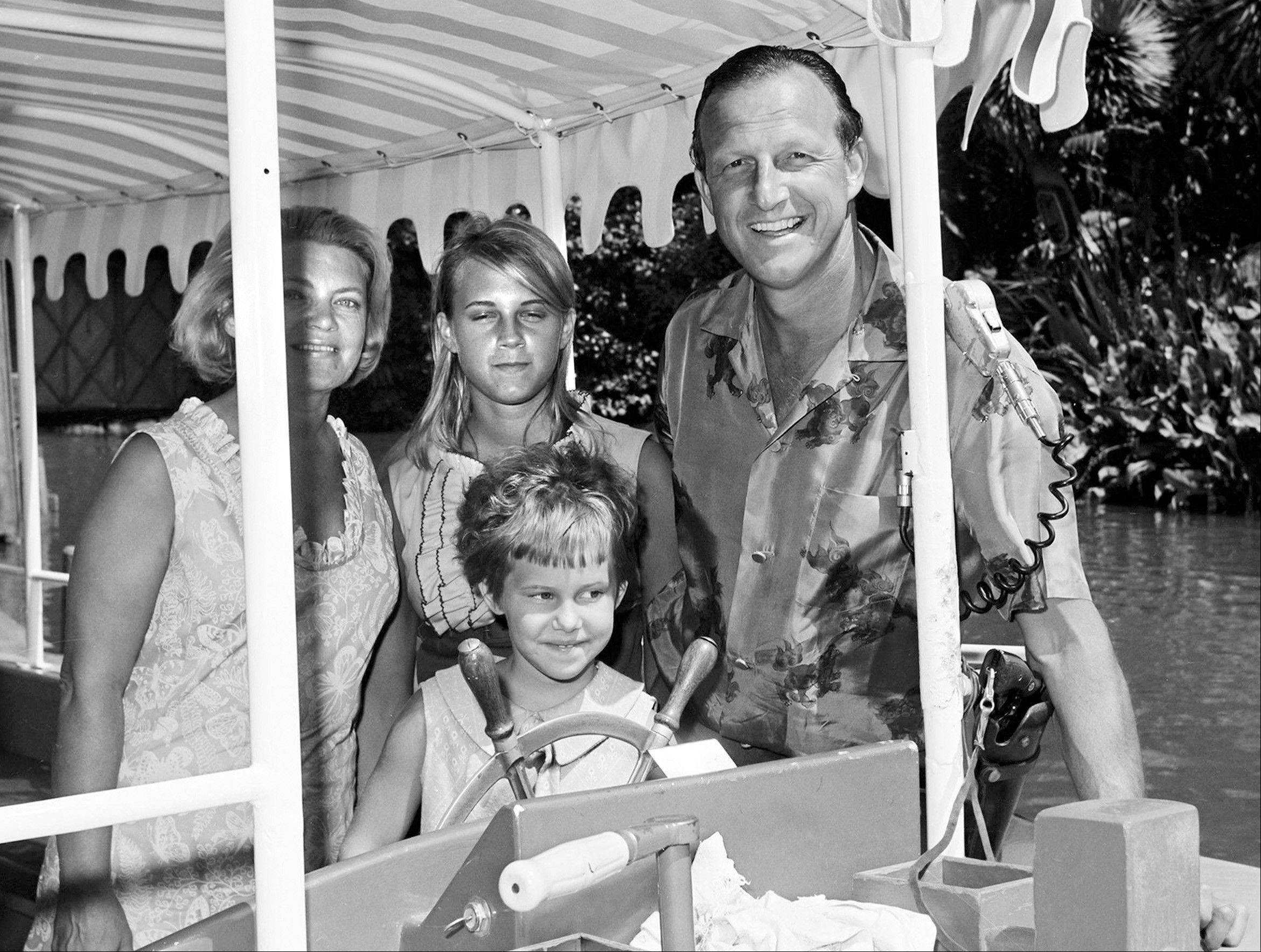 In this July 1965 photo provided by Disneyland, former St. Louis Cardinals' baseball players Stan Musial and his family pose for a photo on the Jungle Cruise attraction at Disneyland in Anaheim, Calif. Musial, one of baseball's greatest hitters and a Hall of Famer with the Cardinals for more than two decades, died Saturday, Jan. 19, 2013, the team announced. He was 92.