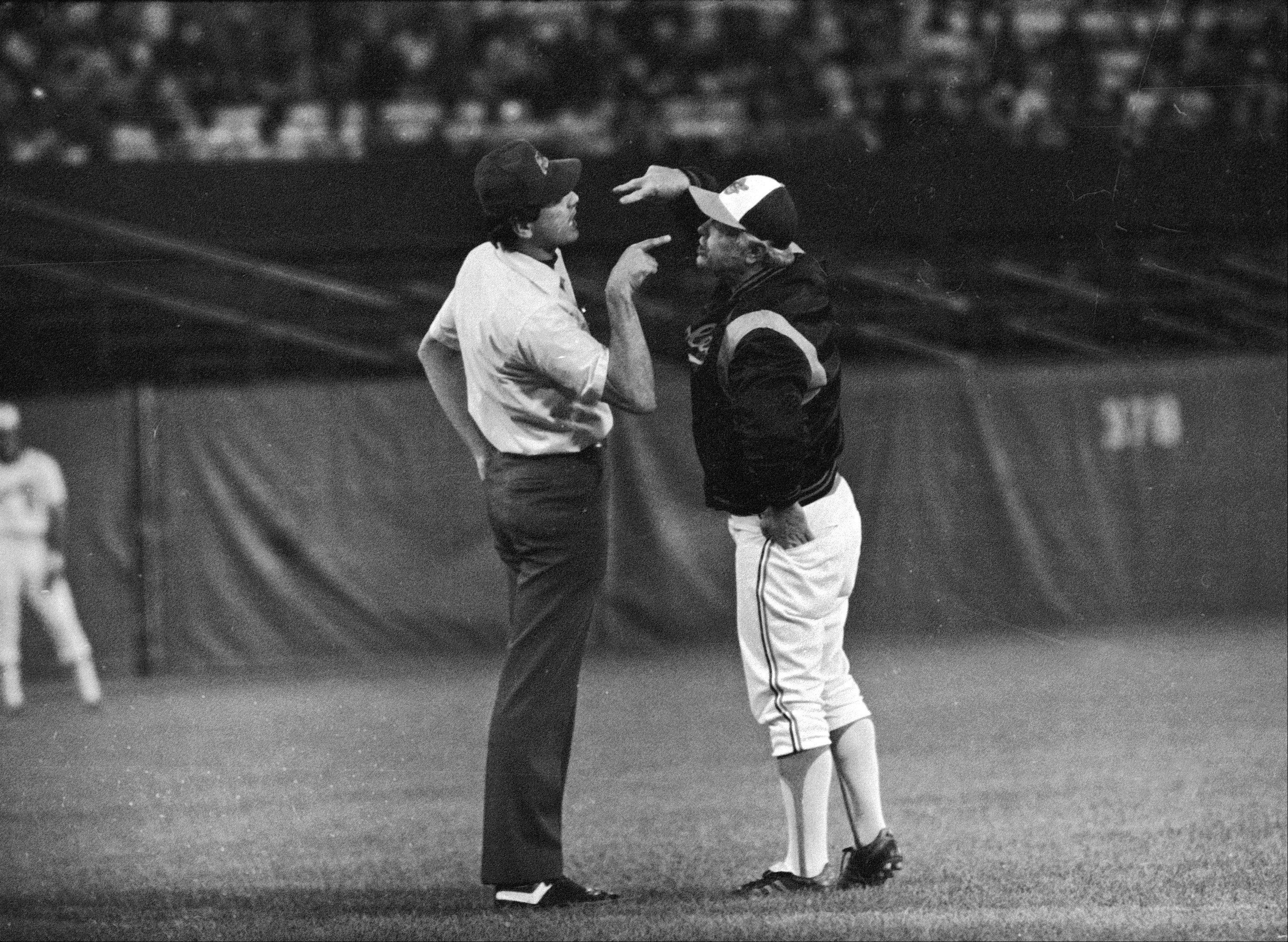 In this Aug. 16, 1979 file photo, Baltimore Orioles manager Earl Weaver argues with third base umpire Steve Palermo, after Palermo ejected him during the second inning of a baseball game against the Kansas City Royals, in Baltimore. Weaver, the fiery Hall of Fame manager who won 1,480 games with the Baltimore Orioles, has died, the team announced Saturday, Jan. 19, 2013. He was 82.