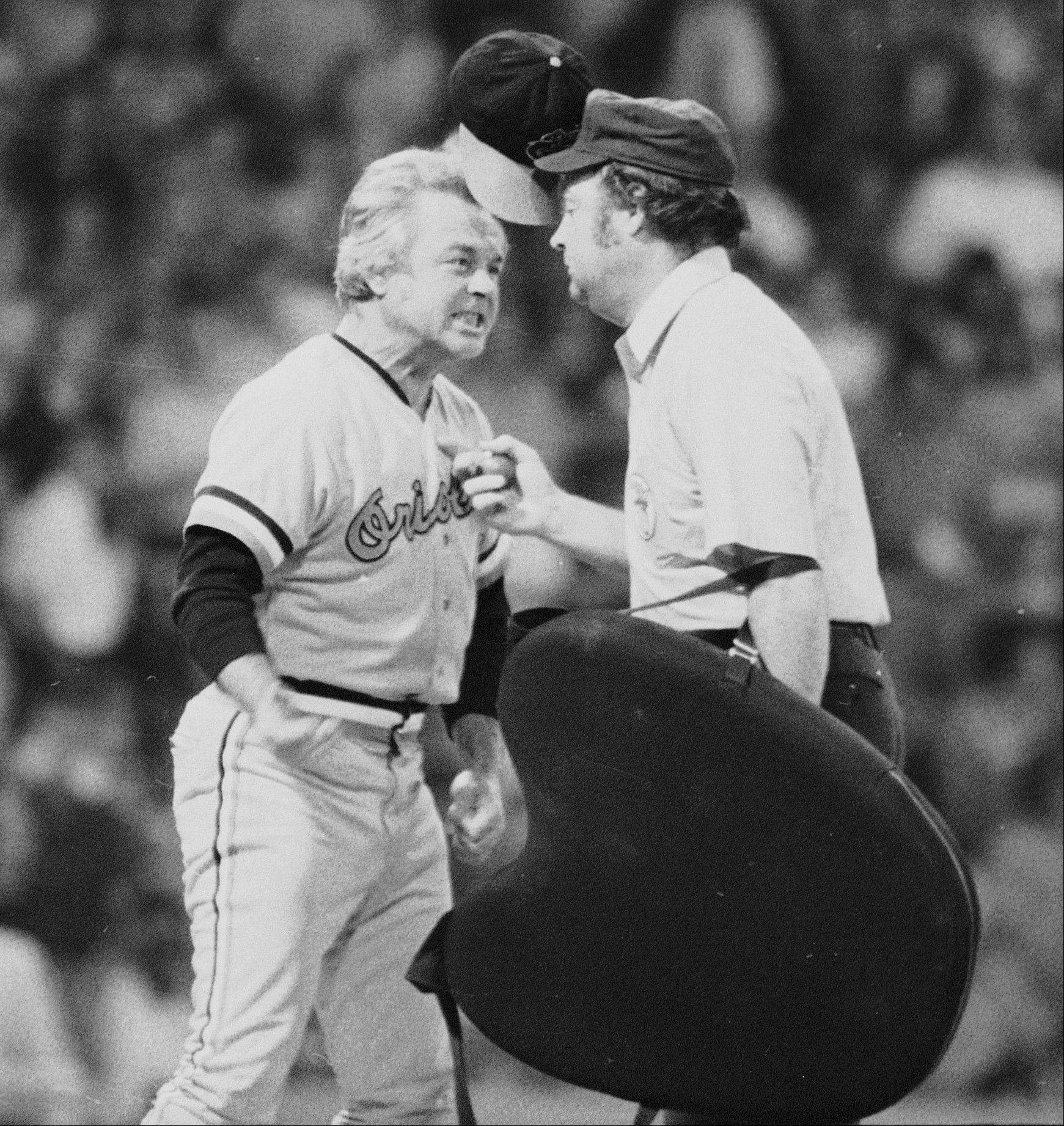 "In this July 13, 1974 file photo, Baltimore Orioles manager Earl Weaver literally ""flips his lid"" as he protests a call by home plate umpire Marty Springstead during a baseball game against the Chicago White Sox in Chicago. Weaver, the fiery Hall of Fame manager who won 1,480 games with the Baltimore Orioles, has died, the team announced Saturday, Jan. 19, 2013. He was 82."