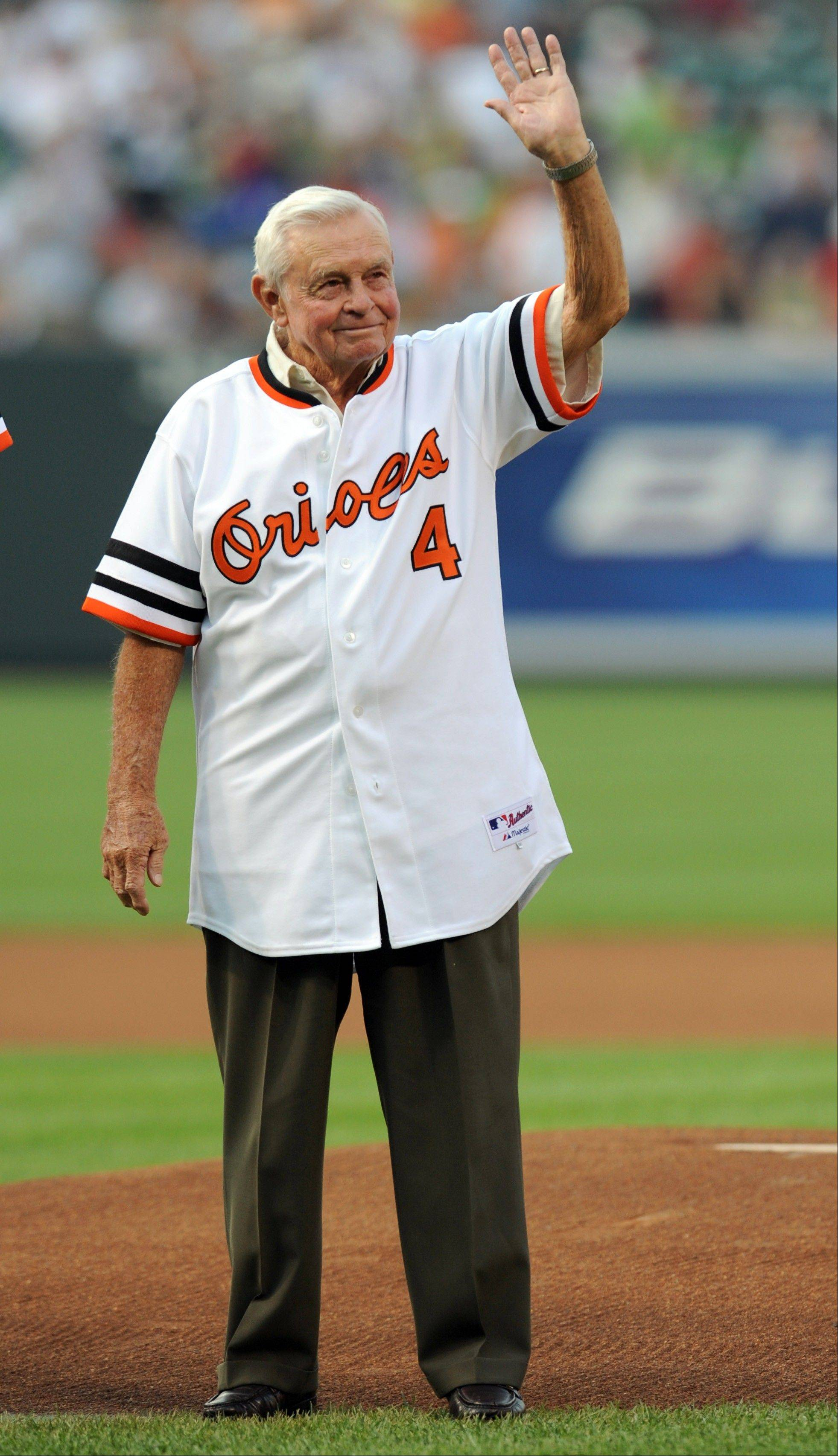 FILE -- In this Friday, June 13, 2008 file photo, former Baltimore Orioles manager Earl Weaver waves to the crowd during a celebration in honor of the 1979 Orioles American League pennant winners before the baseball game between the Baltimore Orioles and Pittsburgh Pirates in Baltimore. Weaver, the fiery Hall of Fame manager who won 1,480 games with the Baltimore Orioles, has died, the team announced Saturday, Jan. 19, 2013. He was 82.